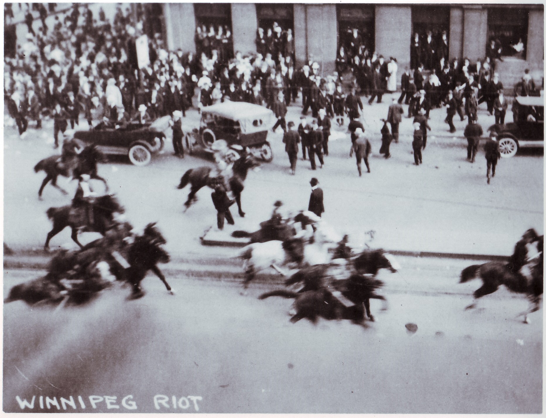 Special constables on horseback rushed through a crowd at the corner of Portage and Main on June 10, 1919 (Archives of Manitoba)