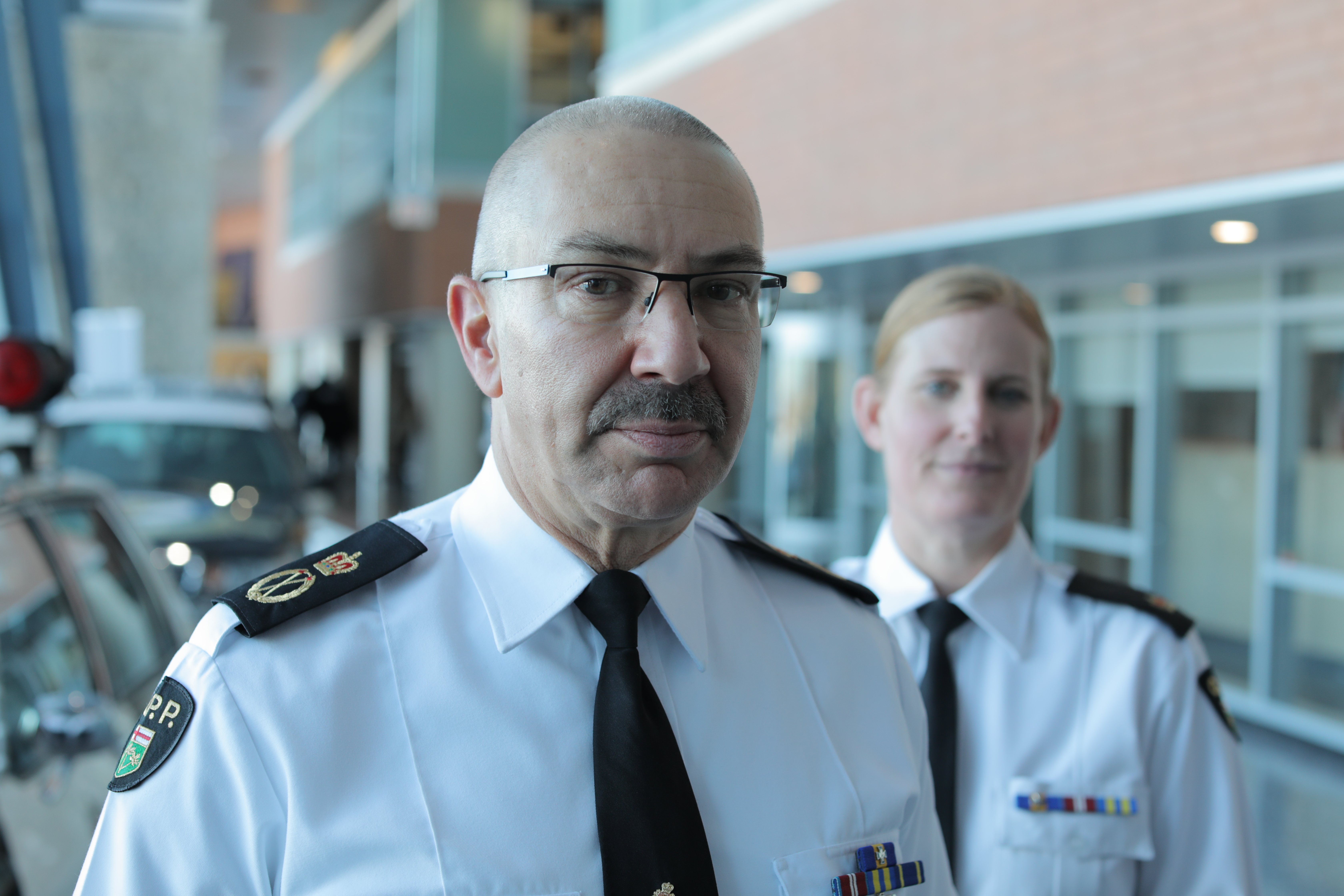Acting OPP Commissioner Gary Couture and Insp. Robyn MacEachern, head of the force's wellness unit, say the force has taken on new initiatives since the 2012 ombudsman's report, including a 23-member peer support program. (John Badcock/CBC)