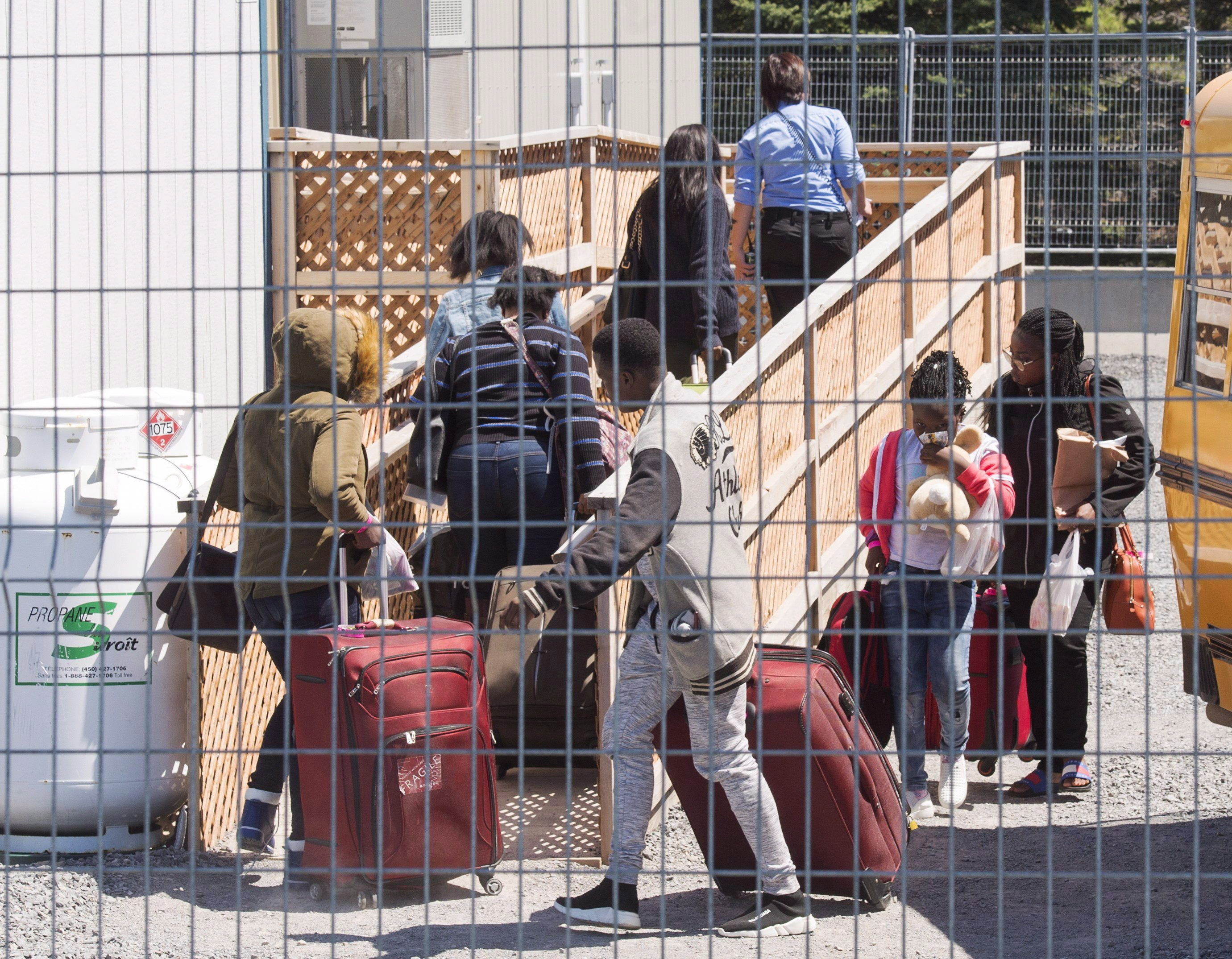 Thousands of migrants have crossed into Canada at Roxham Road, which straddles the Quebec-New York border, in recent months. (Ryan Remiorz/Canadian Press)