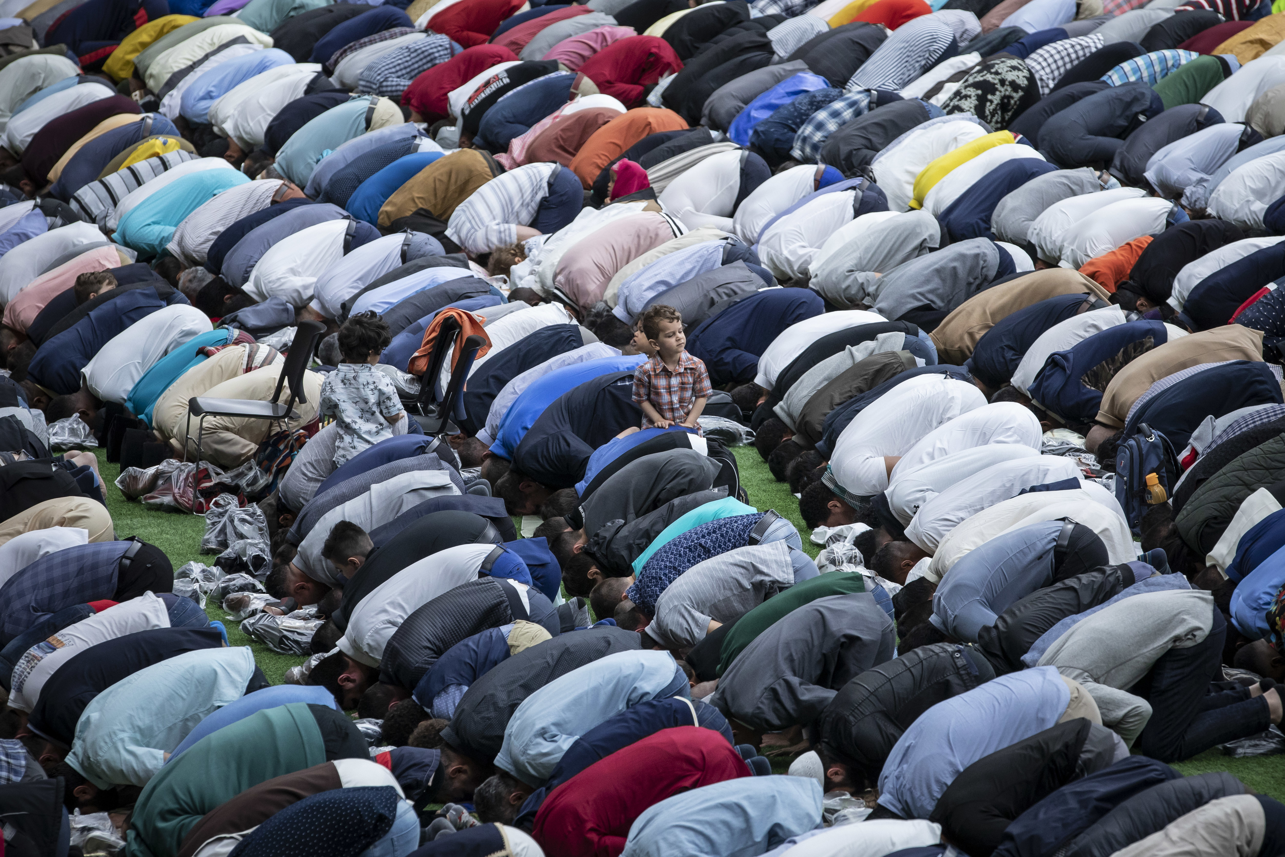 Muslims offer prayers during the first day of Eid al-Fitr, which marks the end of the holy fasting month of Ramadan, at B.C. Place in Vancouver on June 4, 2019. (Ben Nelms/CBC)