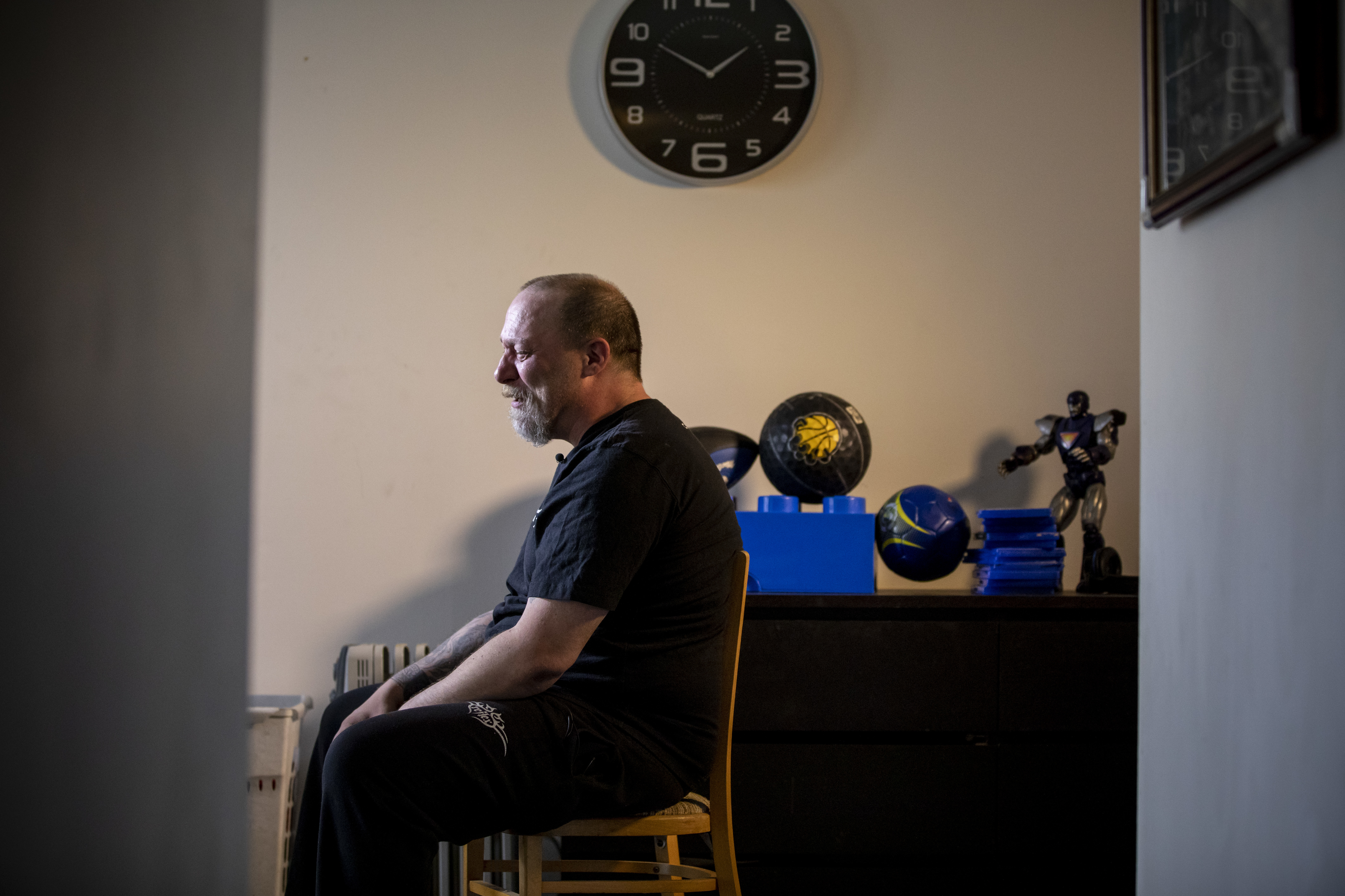 Aron Crimeni, father of 14-year-old Carson Crimeni who died of an apparent overdose, weeps while sitting in his son's room in Langley, British Columbia on Aug. 9, 2019. (Ben Nelms/CBC)