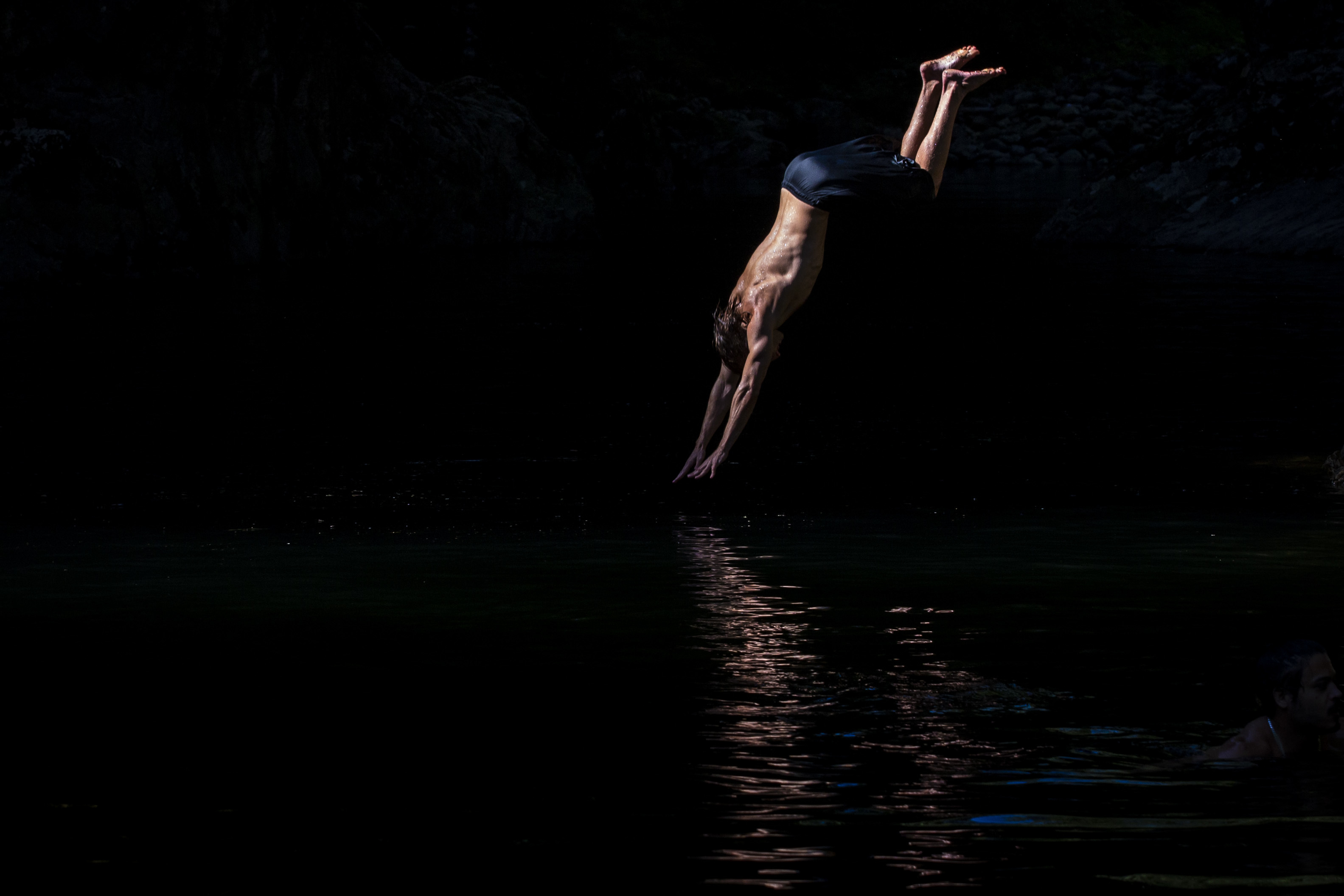 David Frank dives off a cliff into the Capilano river in North Vancouver, B.C., on Aug. 26, 2019. (Ben Nelms/CBC)
