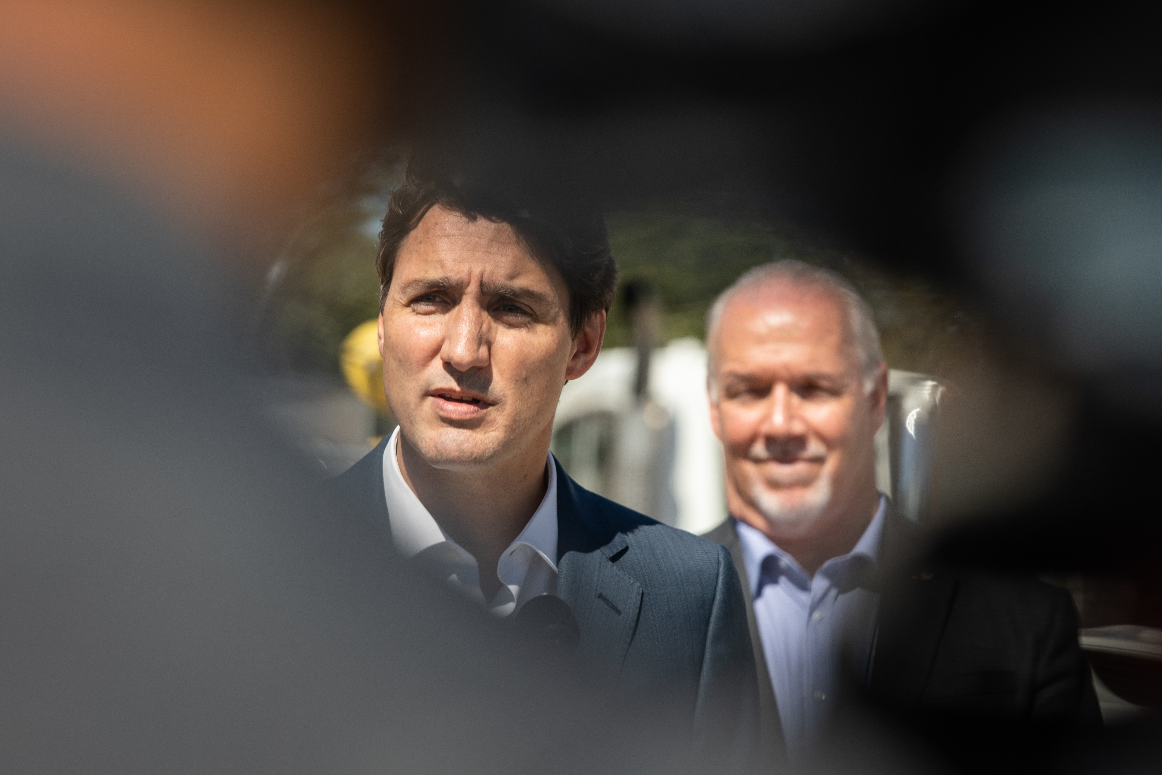 Prime Minister Justin Trudeau and B.C. Premier John Horgan make an announcement at the B.C. Hydro Trades Training Centre in Surrey on Aug. 29, 2019. (Maggie MacPherson/CBC)