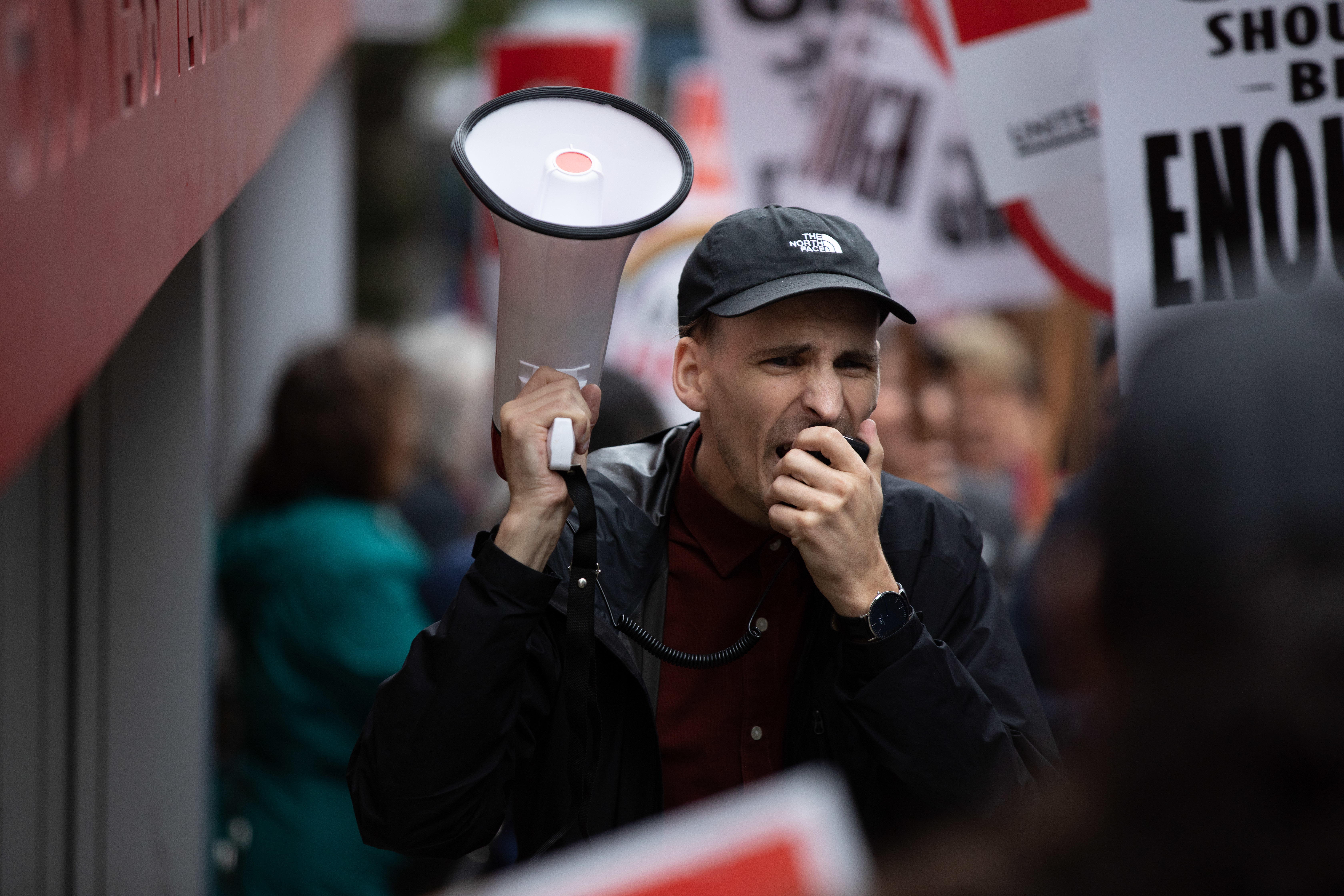 Vancouver's downtown hospitality workers from the Hotel Georgia, Hyatt, Westin Bayshore and Pinnacle Harbourfront hotels walk off the job in a coordinated lunch-hour strike outside the Hyatt Regency Hotel in Vancouver on Sept. 17, 2019. (Maggie MacPherson/CBC)