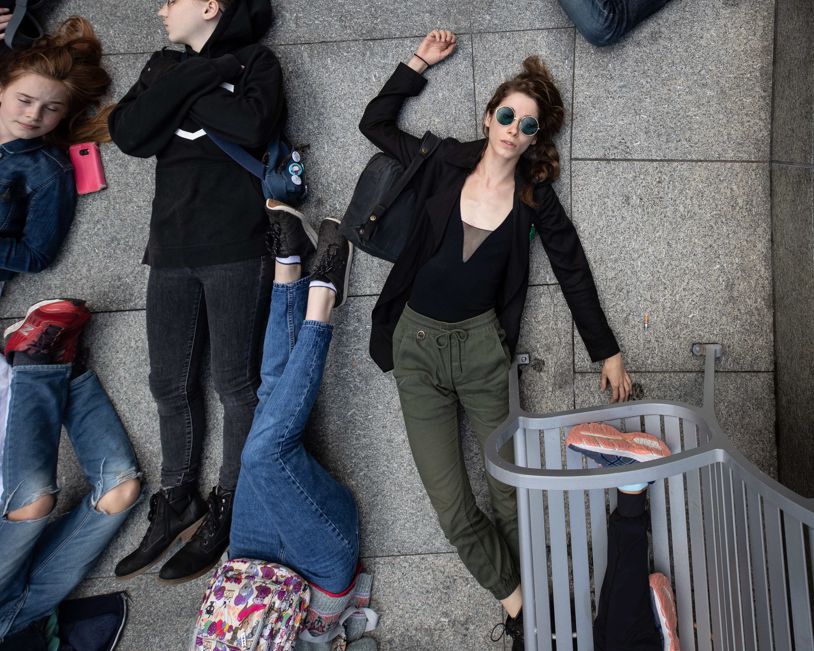 Climate activists perform a die-in outside the Teck Resources building on Sept. 20, 2019. (Maggie MacPherson/CBC)