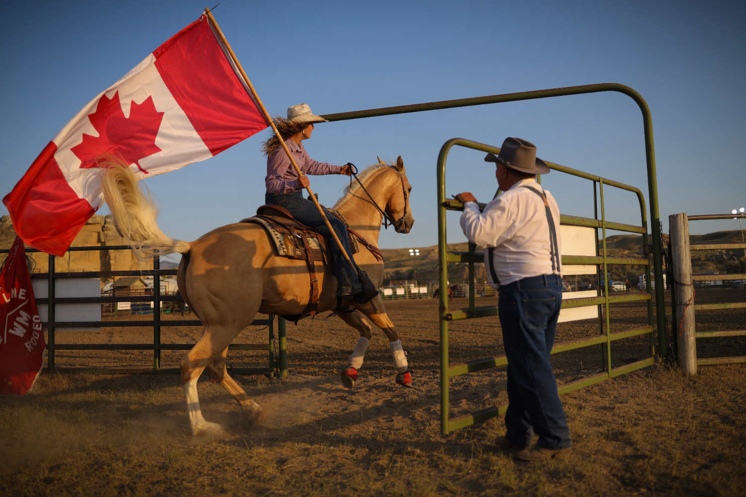 Les O'Hara, who grew up on a homestead on the north side of the Milk River, opens the gates to start off the 54th annual Writing-On-Stone Rodeo.