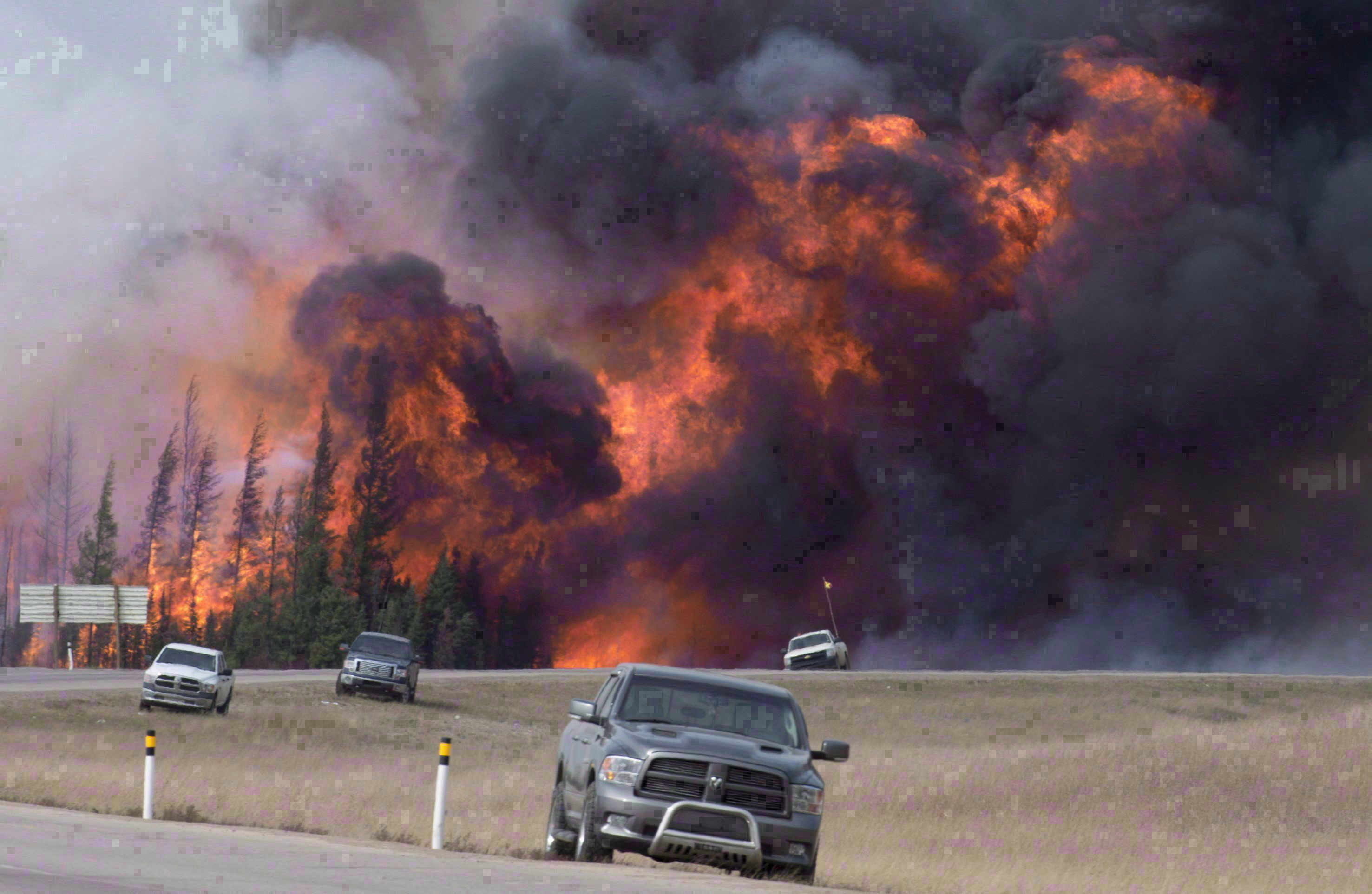 A wildfire ripped through the forest south of Fort McMurray, forcing thousands to flee for their lives. (Jonathan Hayward/The Canadian Press)