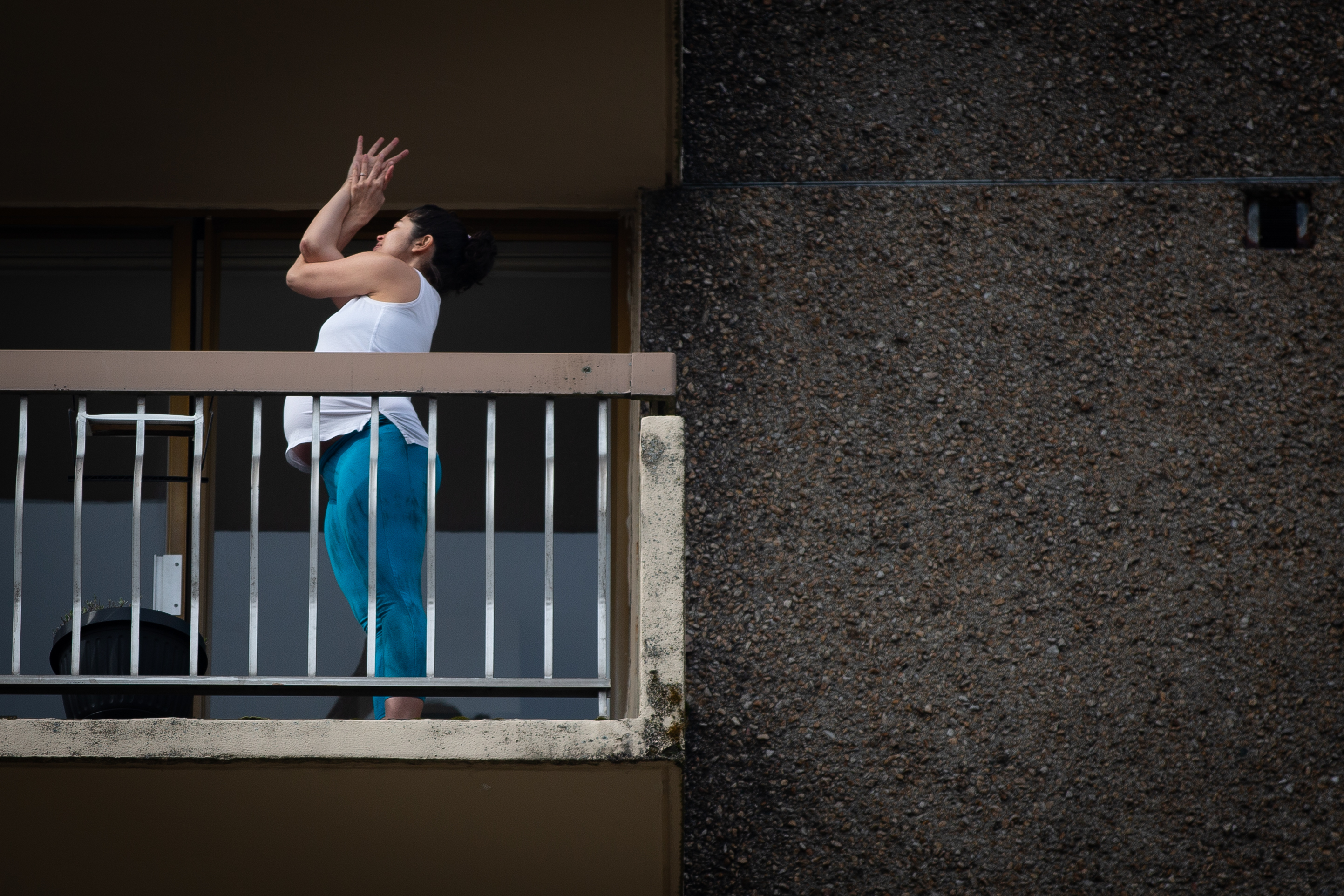 Roberts-Oss practises an arm bind on her balcony.