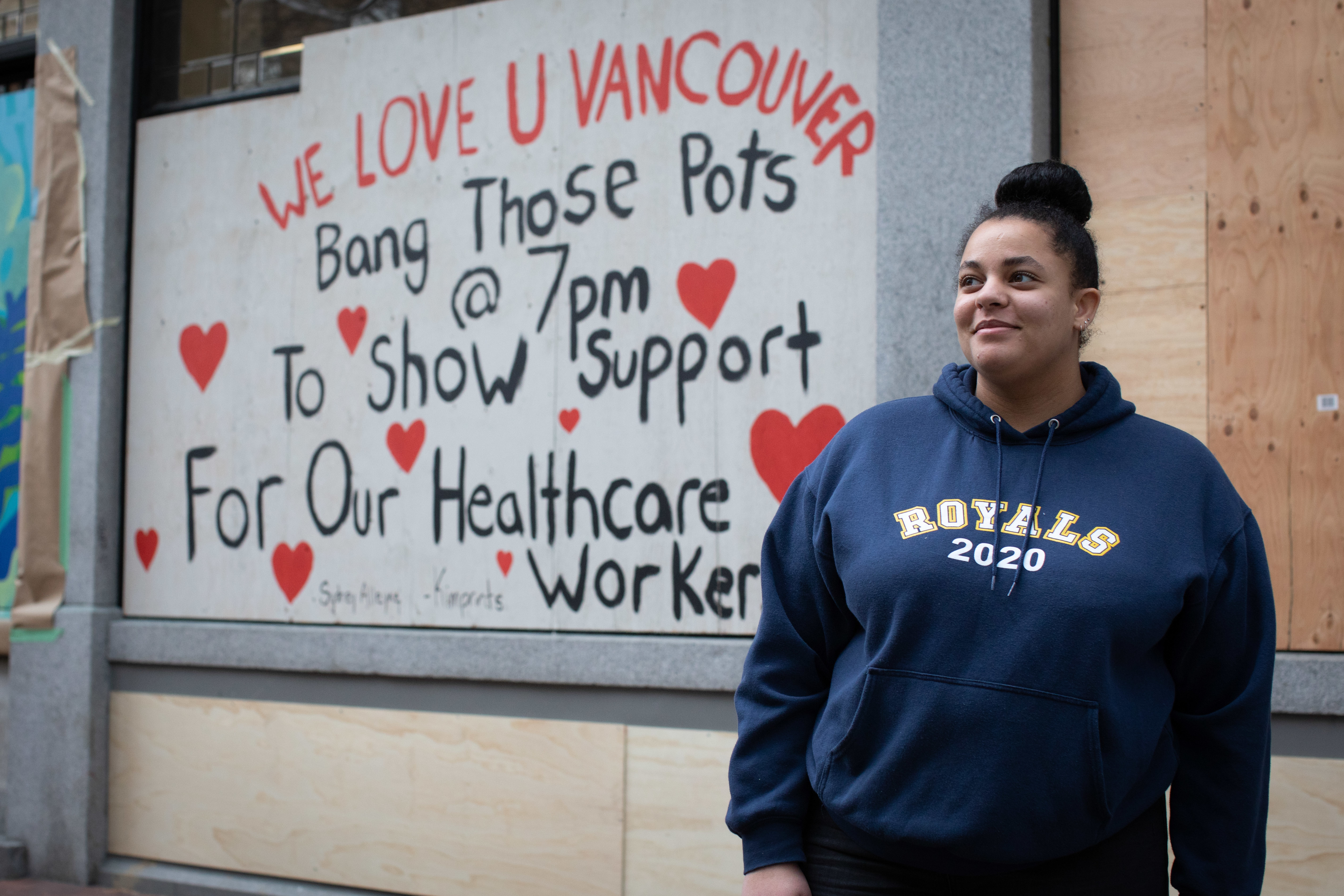 Briscoe's daughter Sydney Alleyne has painted several of the panels, including one that reminds Vancouverites to celebrate health care workers every night at 7 p.m. from their windows and balconies.