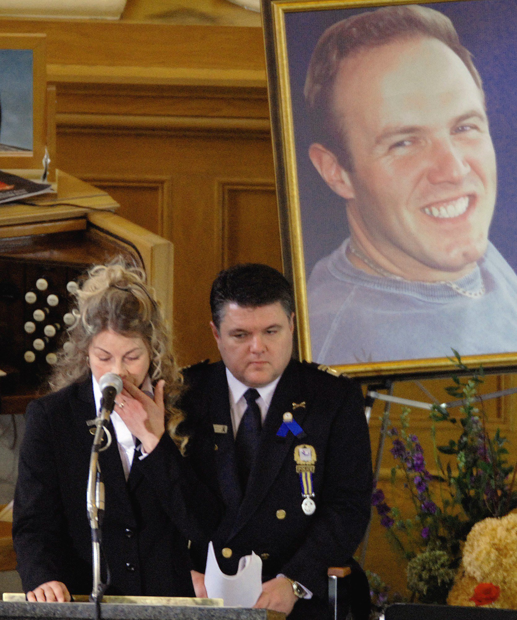 Dominique Lapointe, the widow of Laval police Sgt. Daniel Tessier, fights back tears at his funeral in March 2007. Tessier was shot dead during an early morning drug raid on a home in the Montreal suburbs. (The Canadian Press)