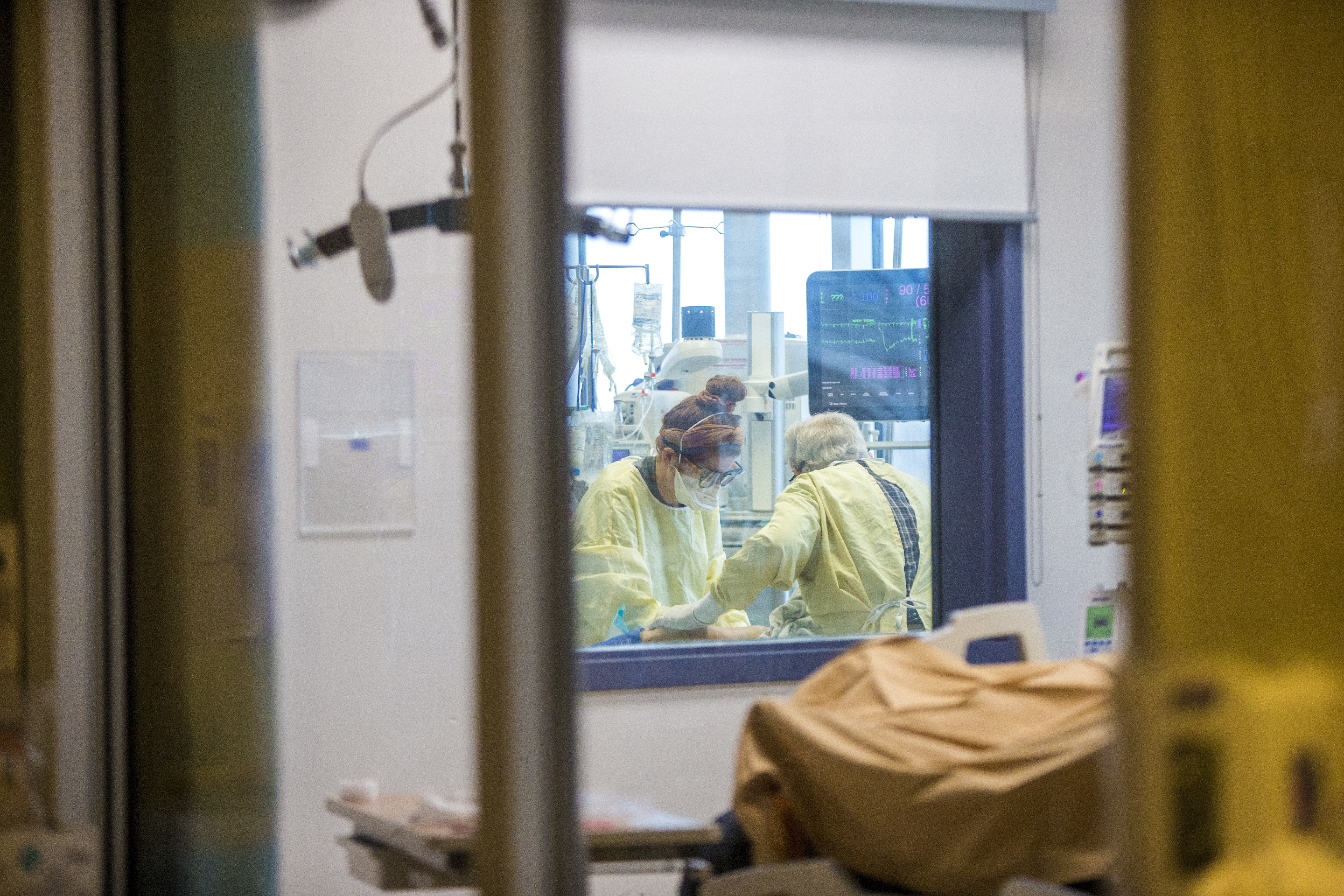 Critical-care workers have been arranged to work in teams as they move through the wards with COVID-19 patient. (Mikaela MacKenzie/Winnipeg Free Press/Canadian Press)