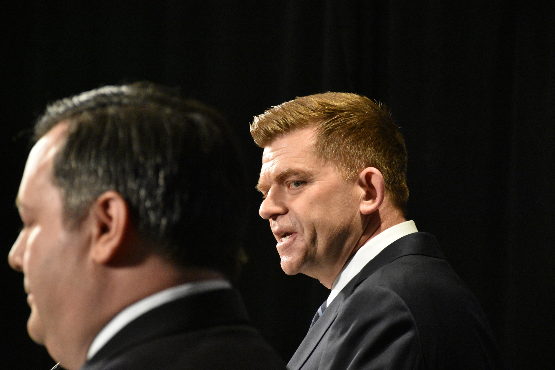 Former Wildrose leader Brian Jean shares a stage with Jason Kenney during the leadership race in 2017. (Terry Reith/CBC)