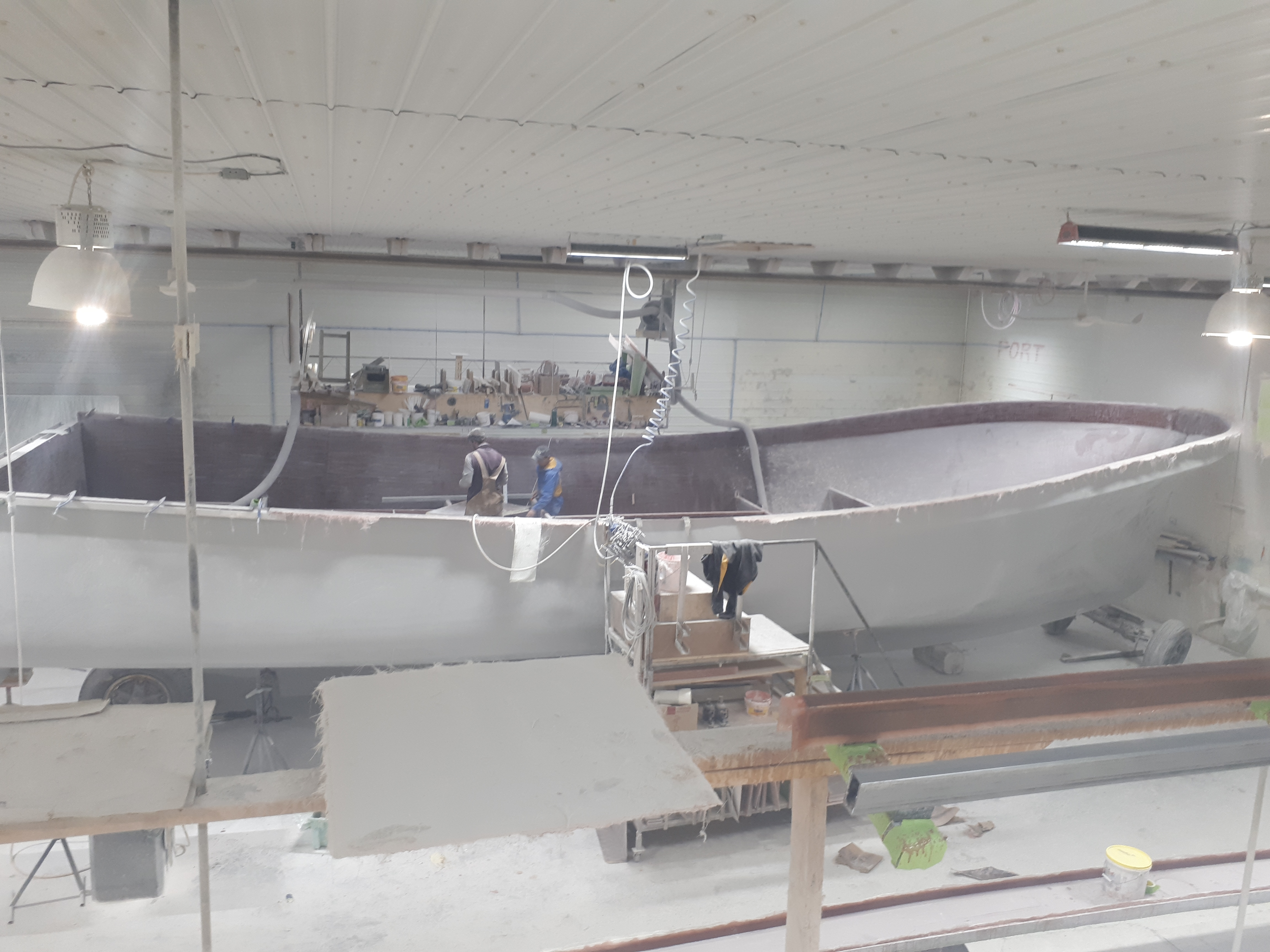 After the Fibreglas boat is pulled from the mould, staff begin installing floors and cabinets. (Submitted by Doucette's Boat Building)