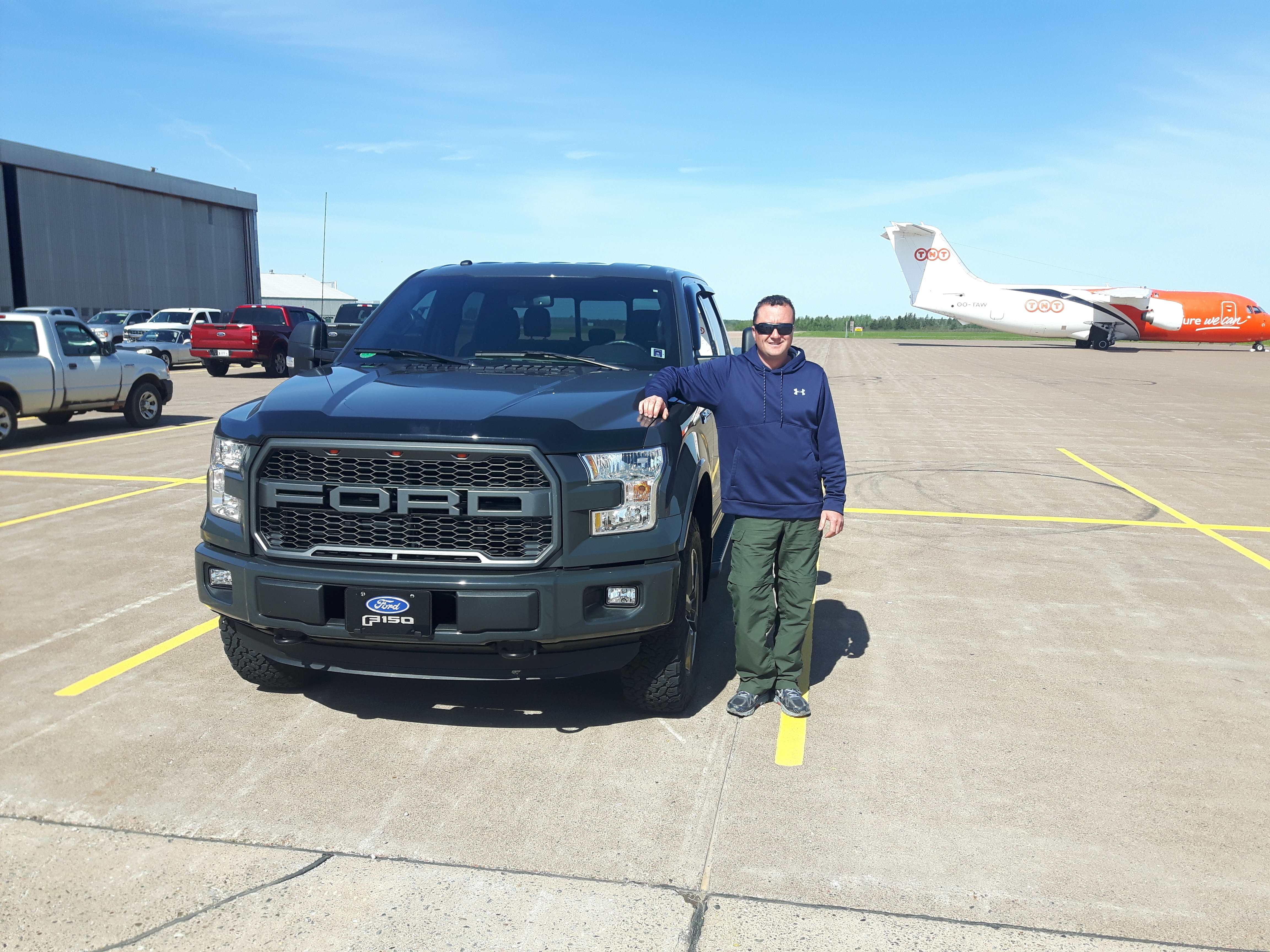 Shawn MacKendrick has spent about $1,000 to replace smashed driving lights and touch up some of the paint chips on his 2016 F-150 truck and he still has to get his cracked windshield replaced. He says it is 'littered with hundreds of little chips.' (Submitted by Shawn MacKendrick)