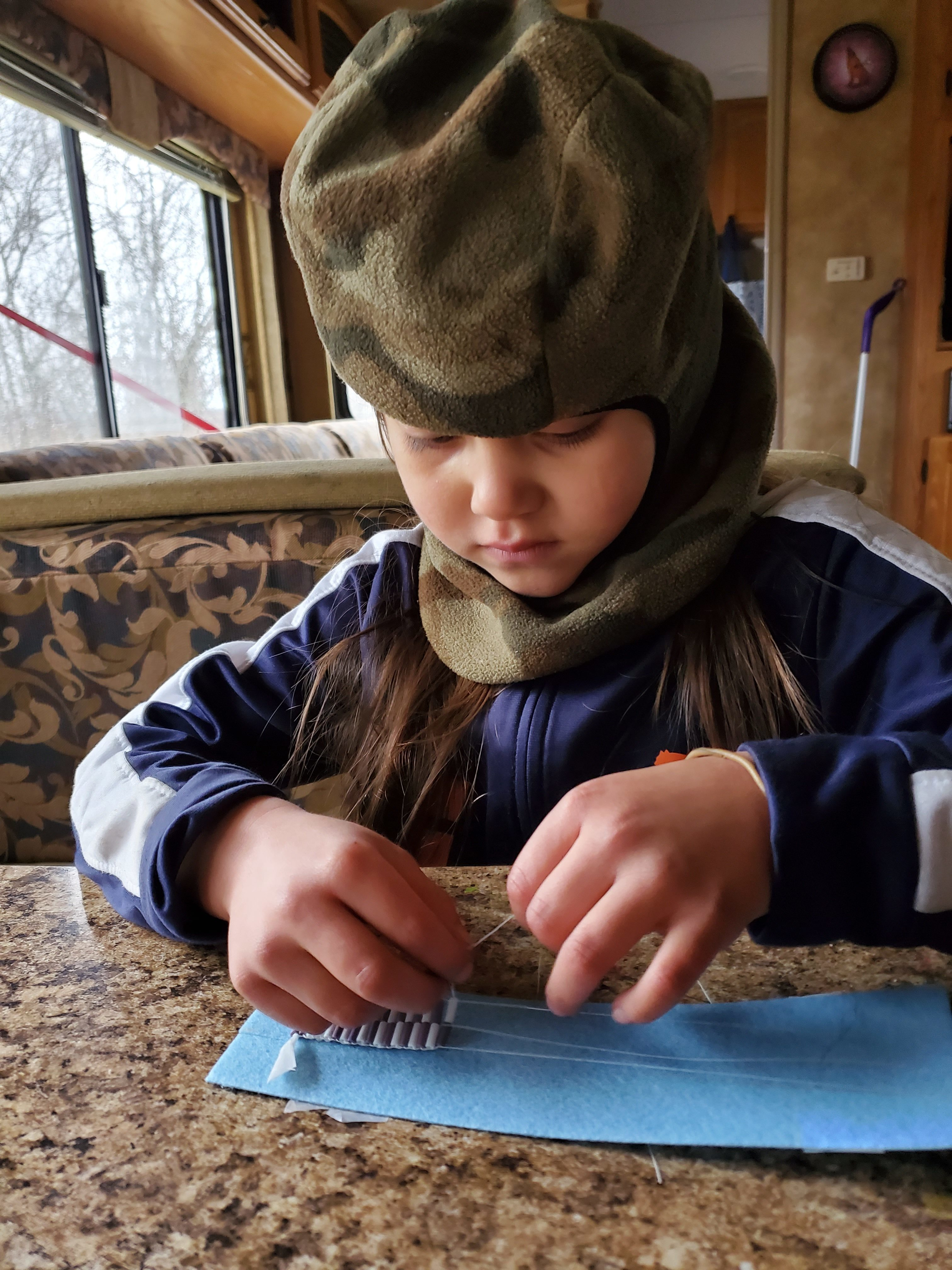 Tehaharotaros learns how to bead traditional Kanien'kehá:ka wampum belts. (Submitted by Jaclyn Hall)