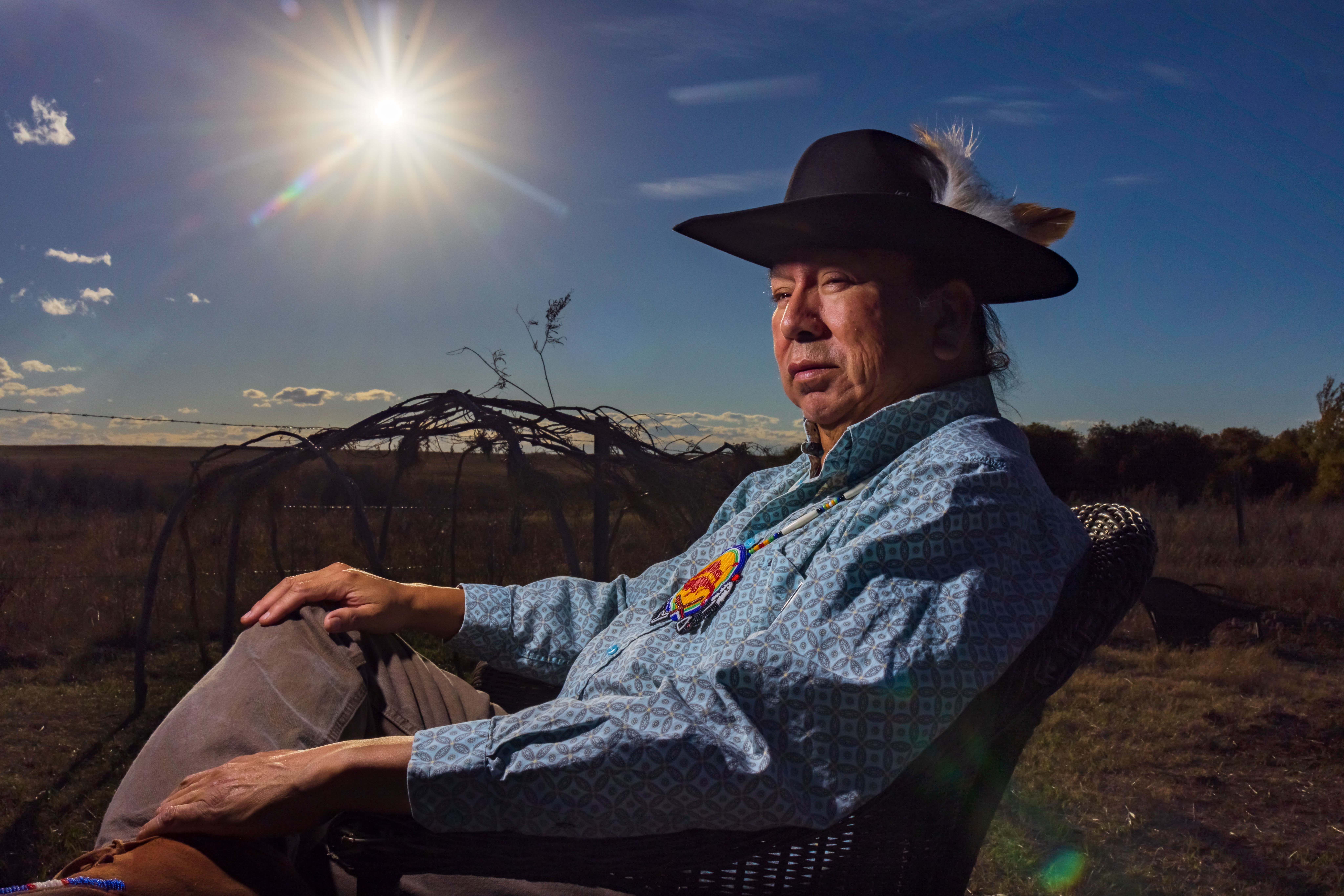 Herman Yellow Old Woman sits outside of his home on Siksika Nation in southern Alberta. (Leah Hennel/For CBC)