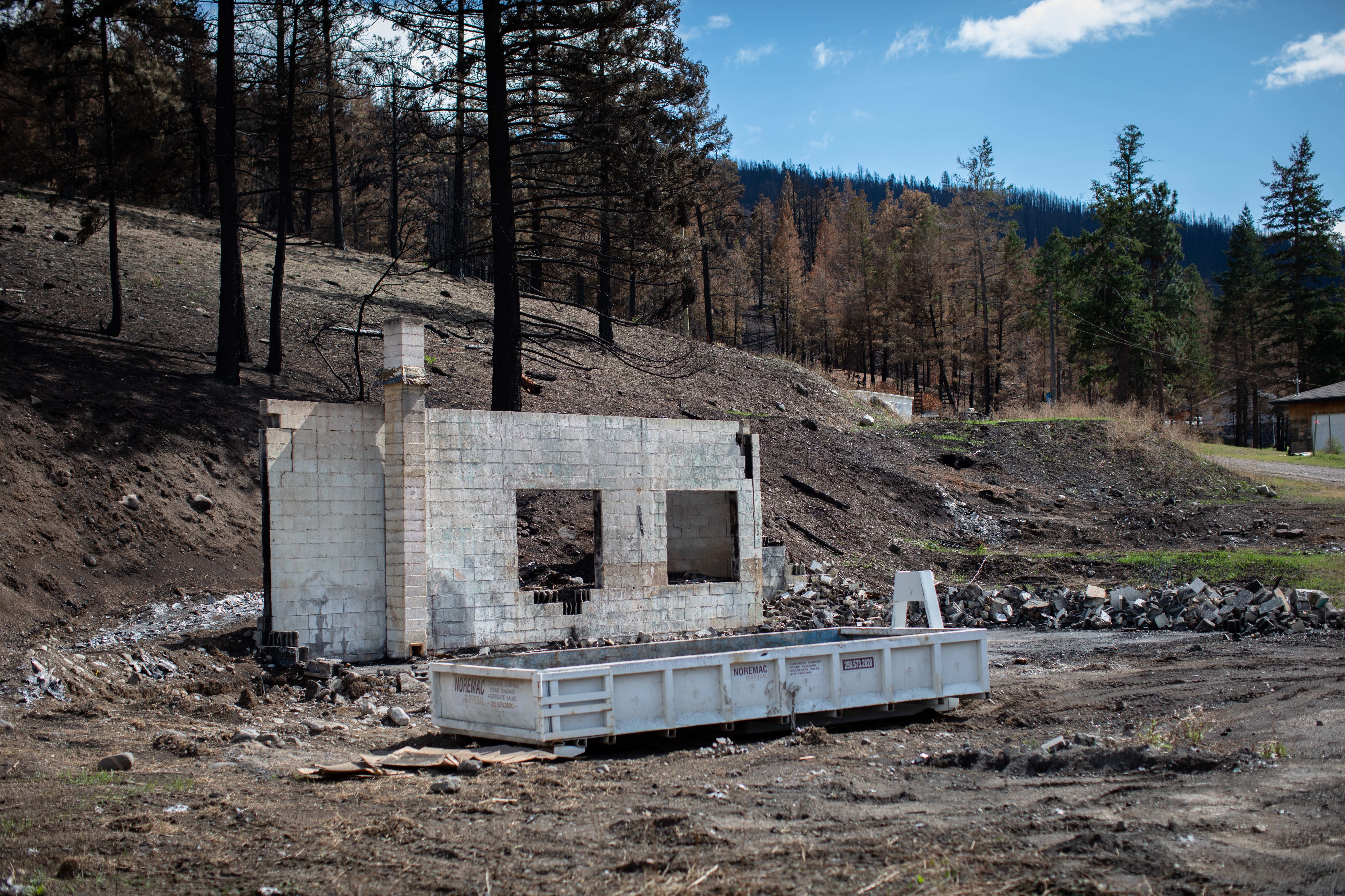 Remnants of a structure burned down by the White Rock Lake wildfire, in Monte Lake, B.C., on Sept. 1. (Maggie MacPherson/CBC)