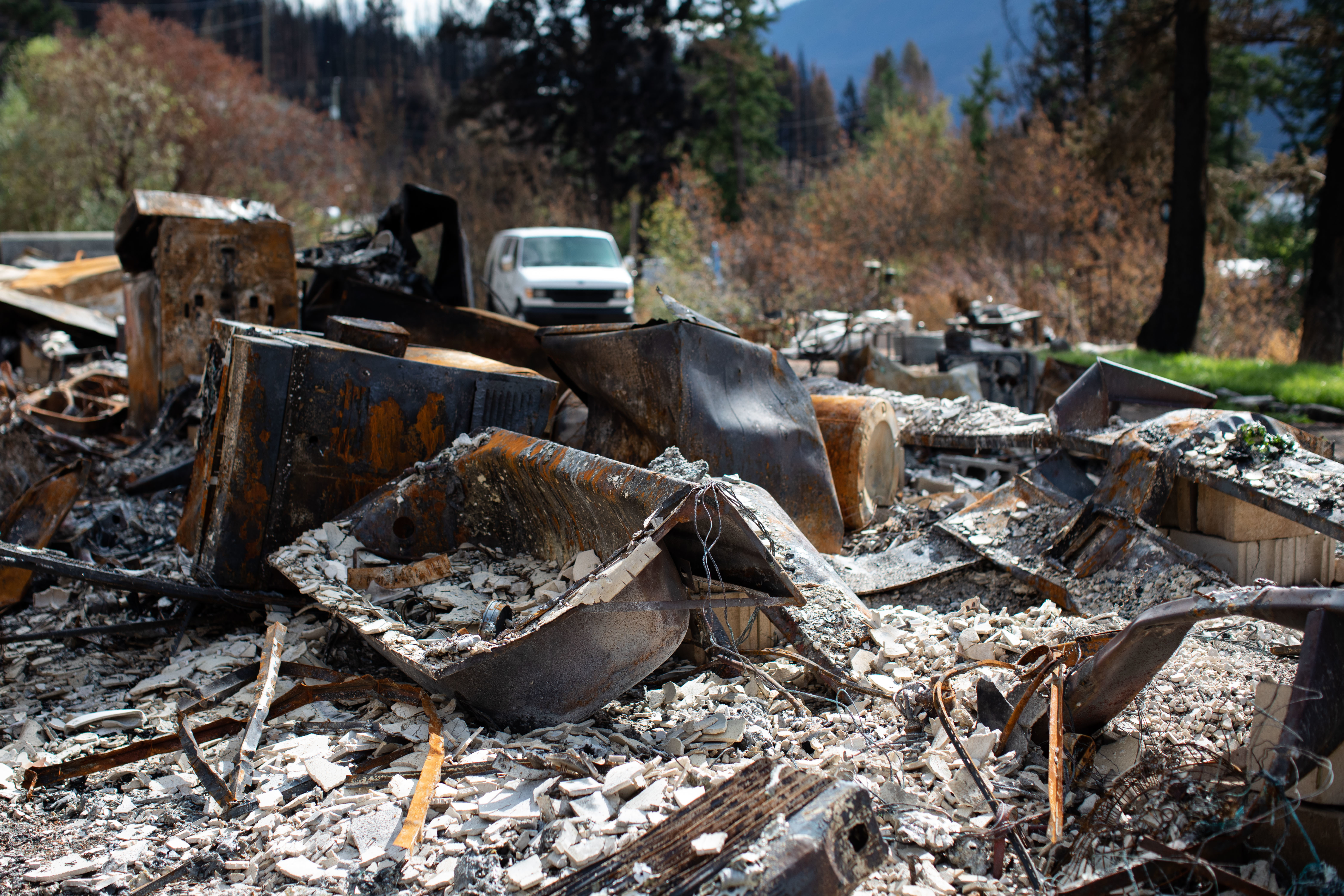 A bathtub lies among the debris from a home that burned down in Monte Lake, B.C., on Sept. 1. The home was destroyed by the White Rock Lake wildfire on Aug. 5. (Maggie MacPherson/CBC)