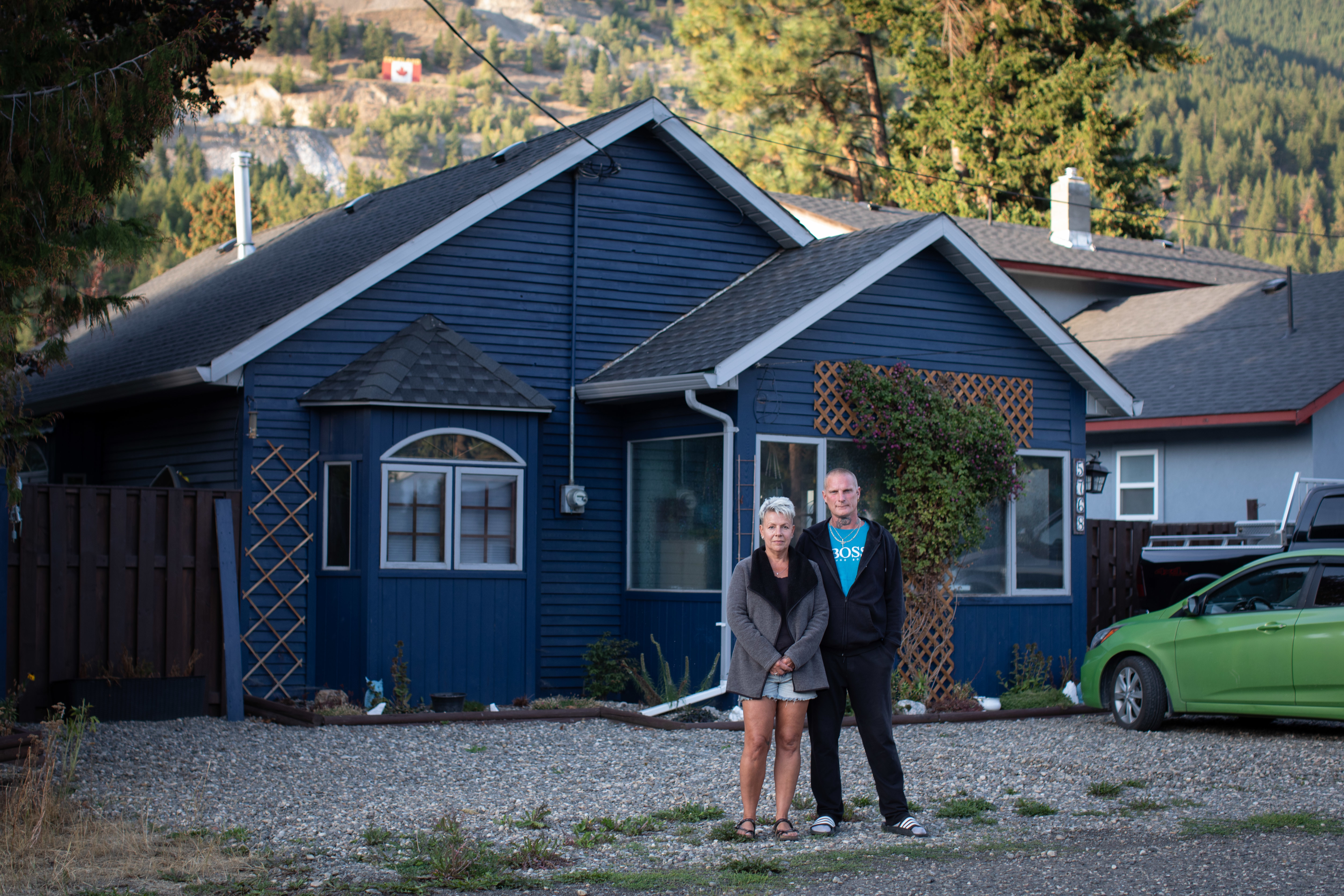 Anna Marsh and Troy Wrixon outside their home in Falkland, B.C., on Sept. 1. They had just moved to the rural community from Chilliwack when they were told to evacuate on Aug. 5. (Maggie MacPherson/CBC)