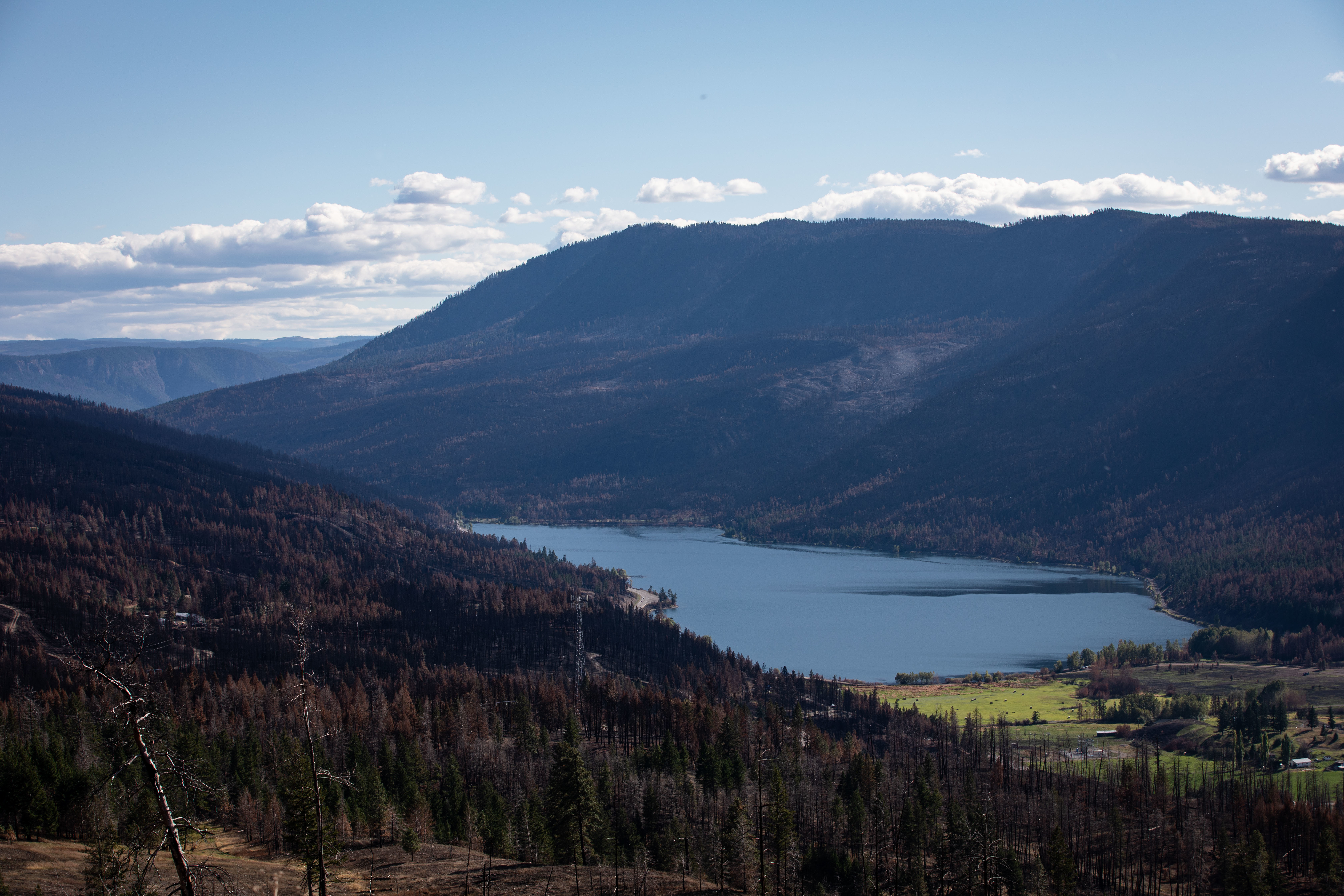 Monte Lake, shown on Sept. 2, sits between hillsides where many 'off-the-grid' residents lost their homes to the White Rock Lake wildfire. (Maggie MacPherson/CBC)