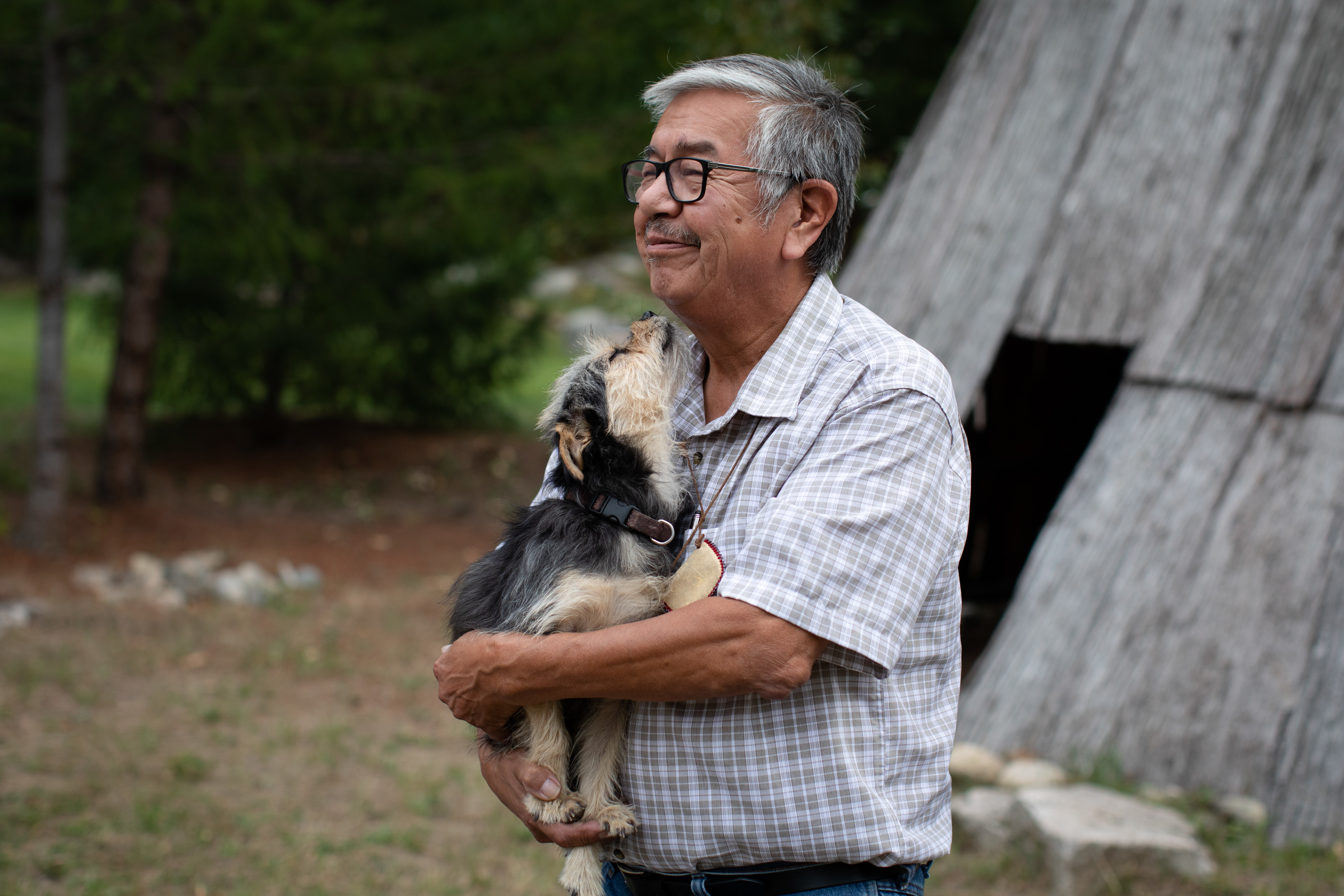 Byron Spinks, a member of Lytton First Nation, holds his dog, Baby, whom he lost during the wildfire and was reunited with weeks later, in Boston Bar, B.C., on Sept. 3. (Maggie MacPherson/CBC)