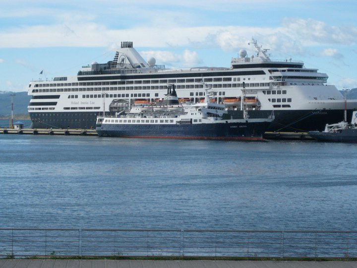 The MV Lyubov Orlova, dwarfed by a much larger Holland America cruise ship, in the port of Ushuaia, Argentina, during the 2009-2010 Antarctic cruise season. (Randi Beers)
