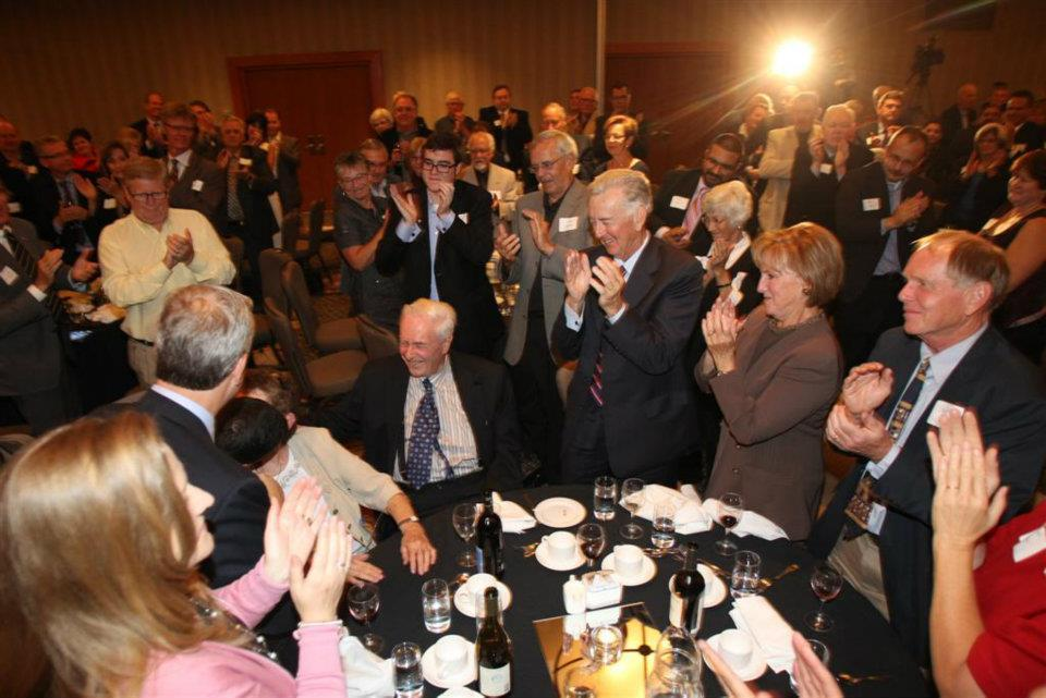 Byfield, seated centre, received a standing ovation from former staffers and politicians like Manning in 2011. (Tom Braid)