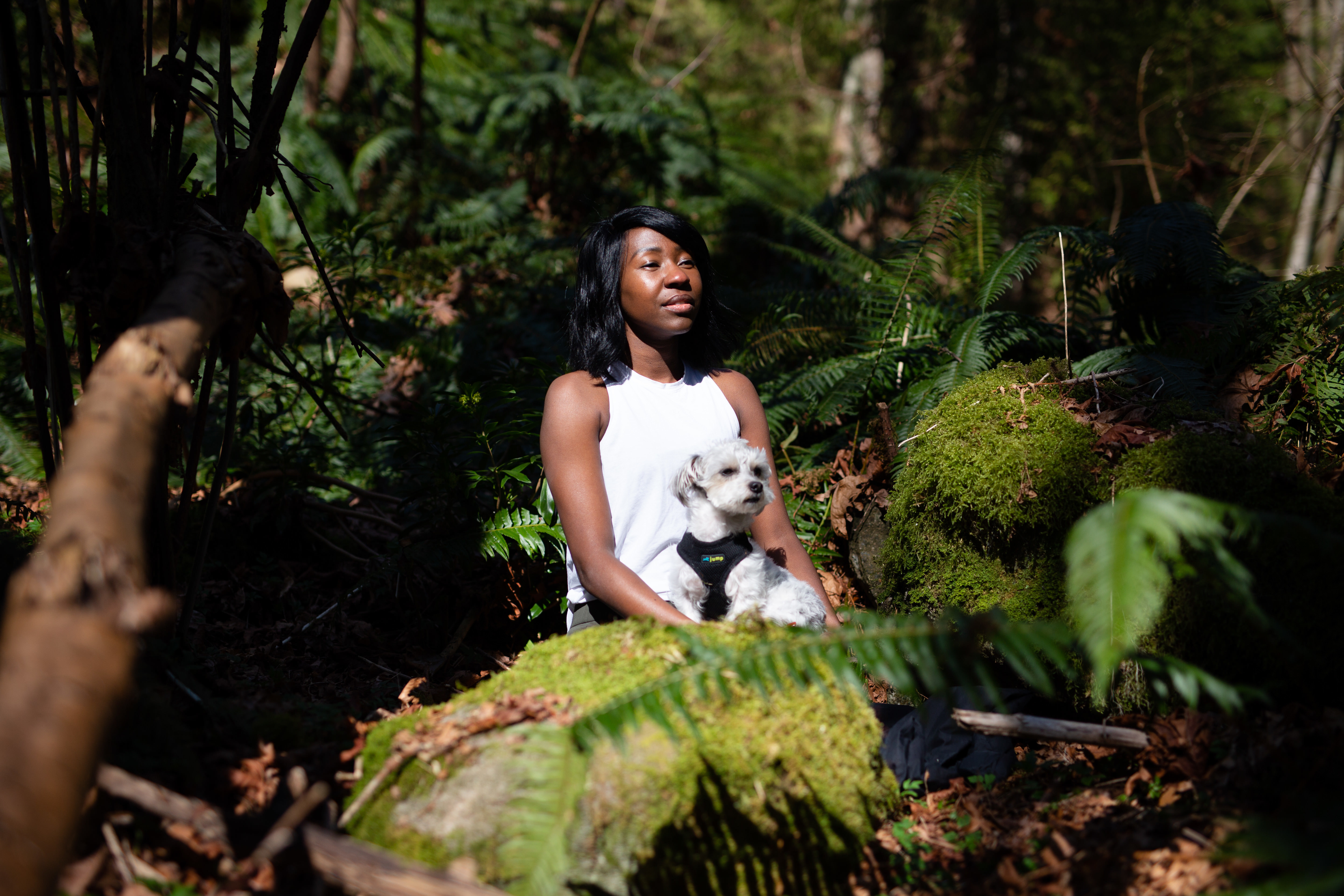 Nkomo meditates in the woods with her dog Hobbs. The forest is nice, but she says you can meditate anywhere.