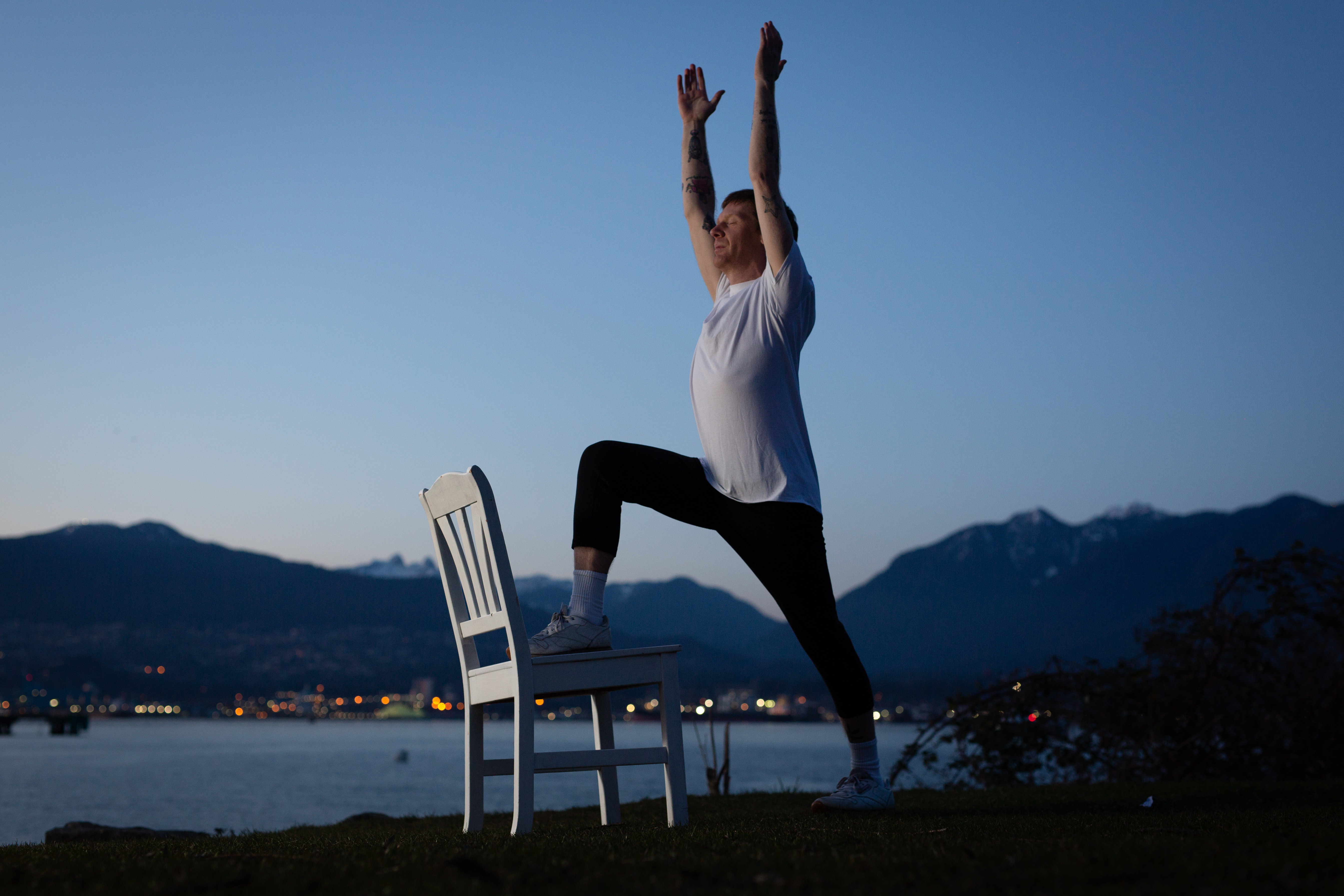 Tim Bang uses a chair to make yoga more accessible for students.