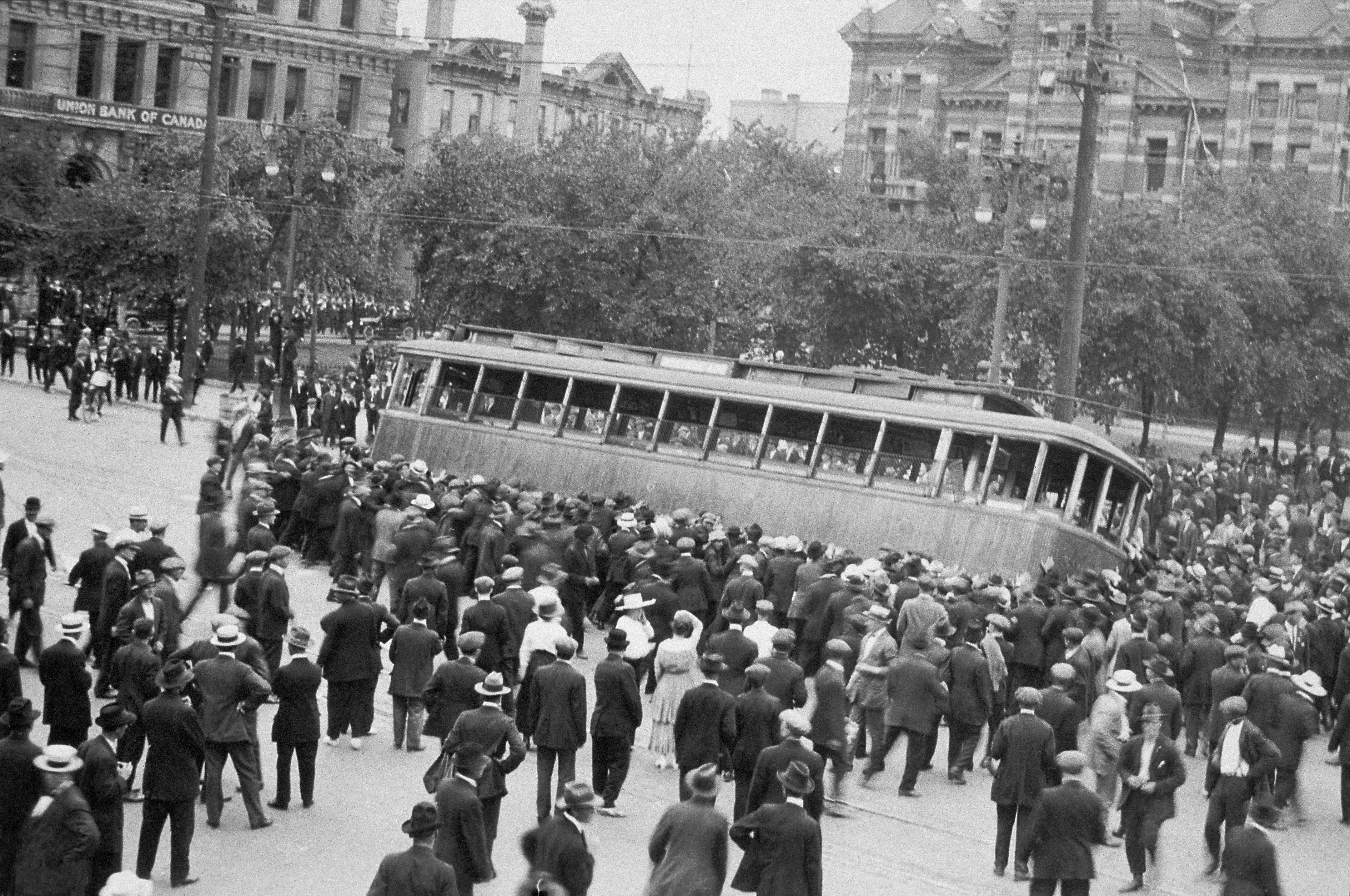 A streetcar is overturned in Winnipeg on June 21, 1919, which became known as Bloody Saturday, during the 1919 Winnipeg General Strike. (Foote collection/Archives of Manitoba)