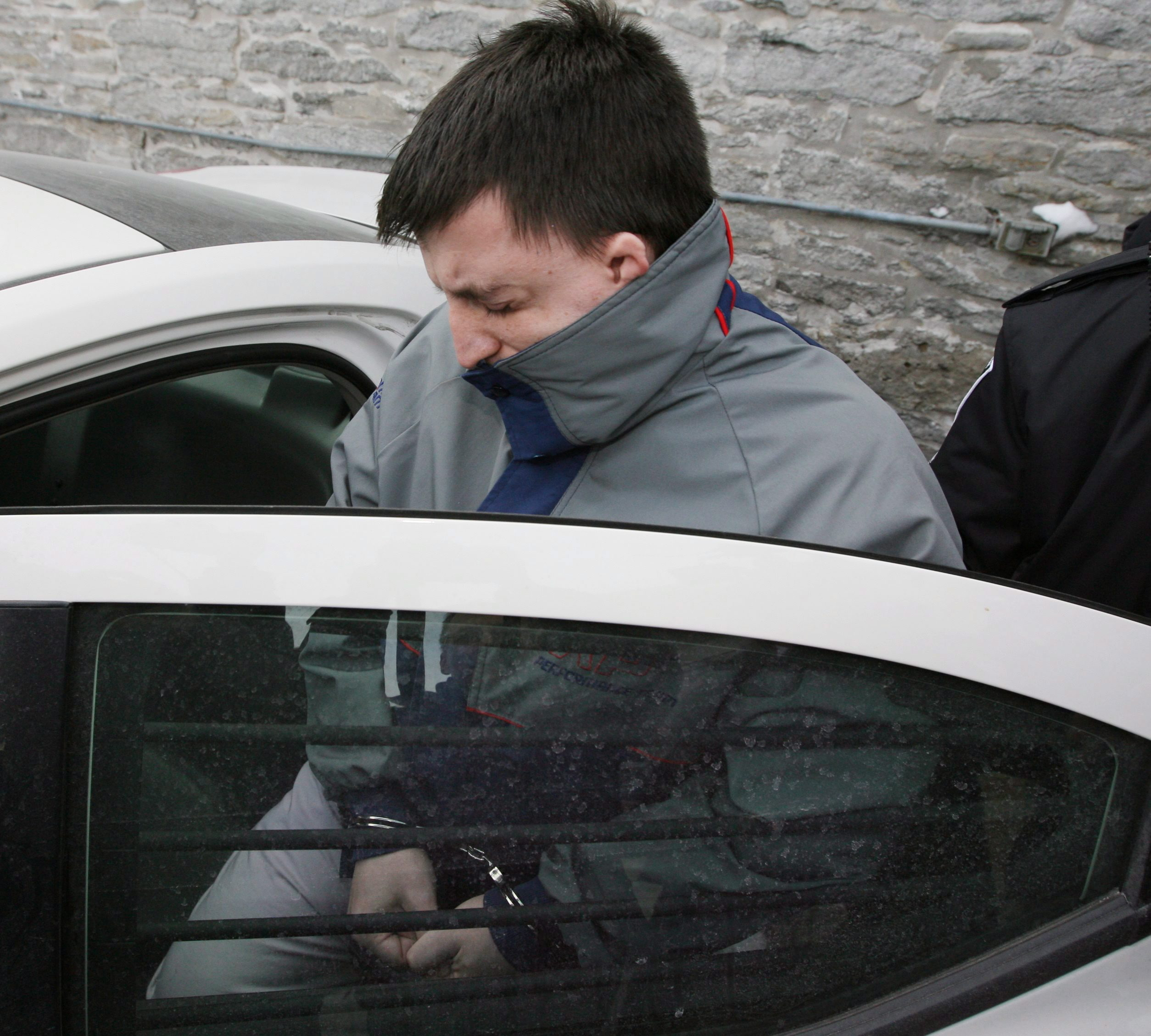 Stanley Tippett gets into a car outside the Superior Court of Justice in Peterborough, Ont., on Dec. 23, 2009 after being handed a guilty verdict in the kidnap and sexual assault of a 12-year-old girl. (Peter Redman/The Canadian Press)