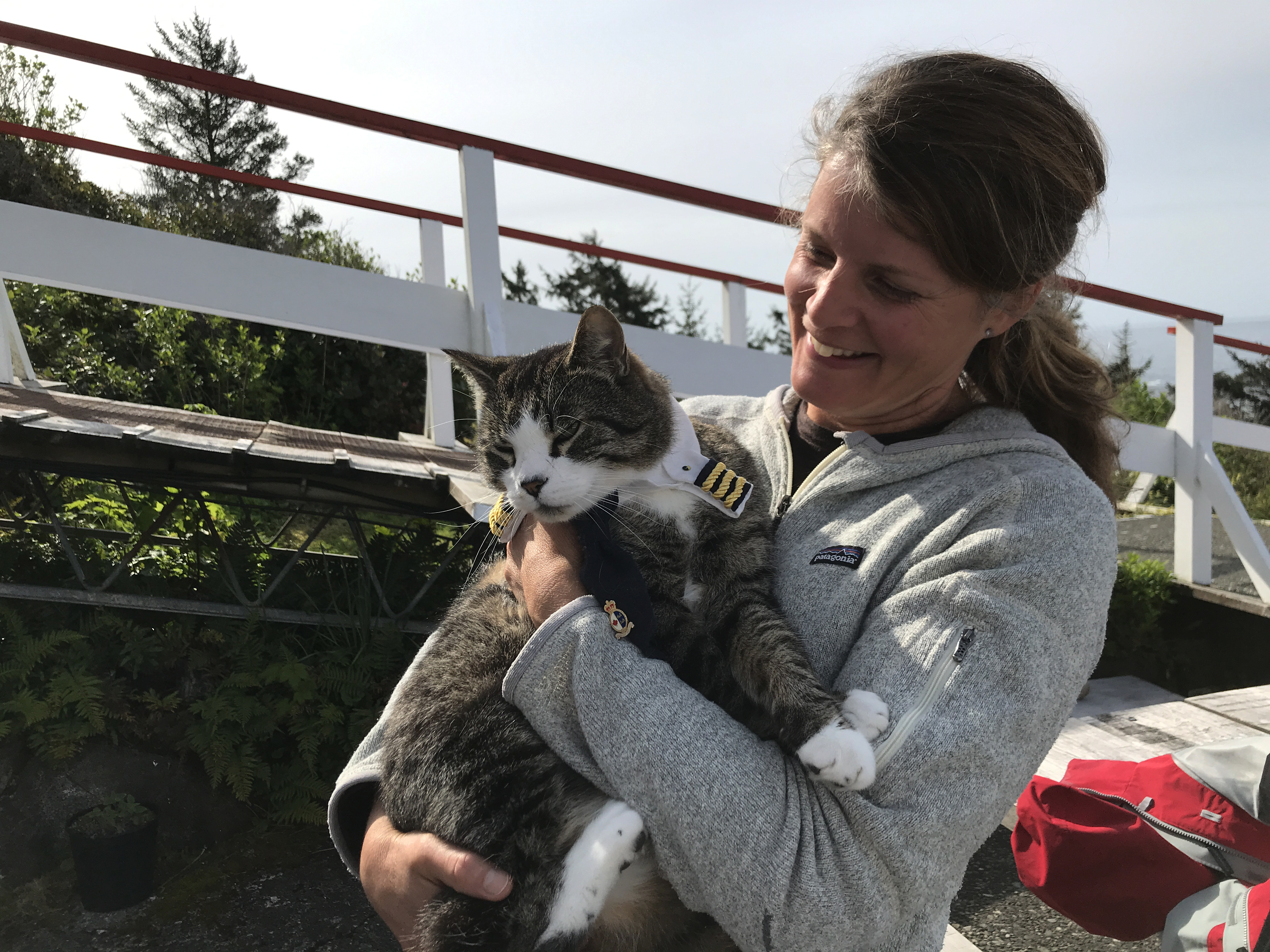 Zacharuk's cat Cash enjoys roaming the grounds of the lighthouse, and even has his own Canadian Coast Guard uniform. (Megan Thomas/CBC)