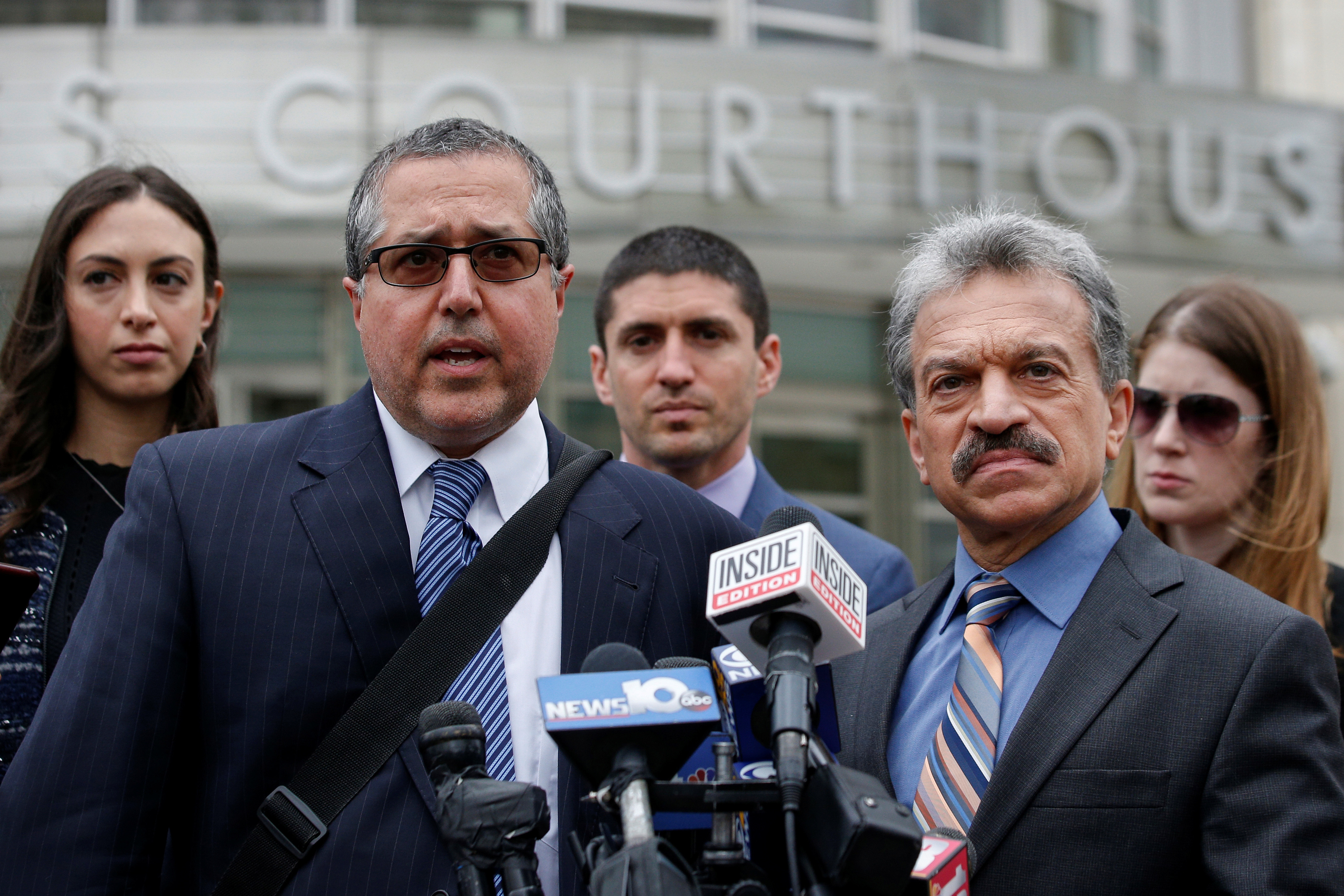 Raniere's lawyers, Marc Agnifilo, left, and Paul DerOhannesian, speak to reporters following a court hearing in New York City on May 4, 2018. (Brendan McDermid/Reuters)
