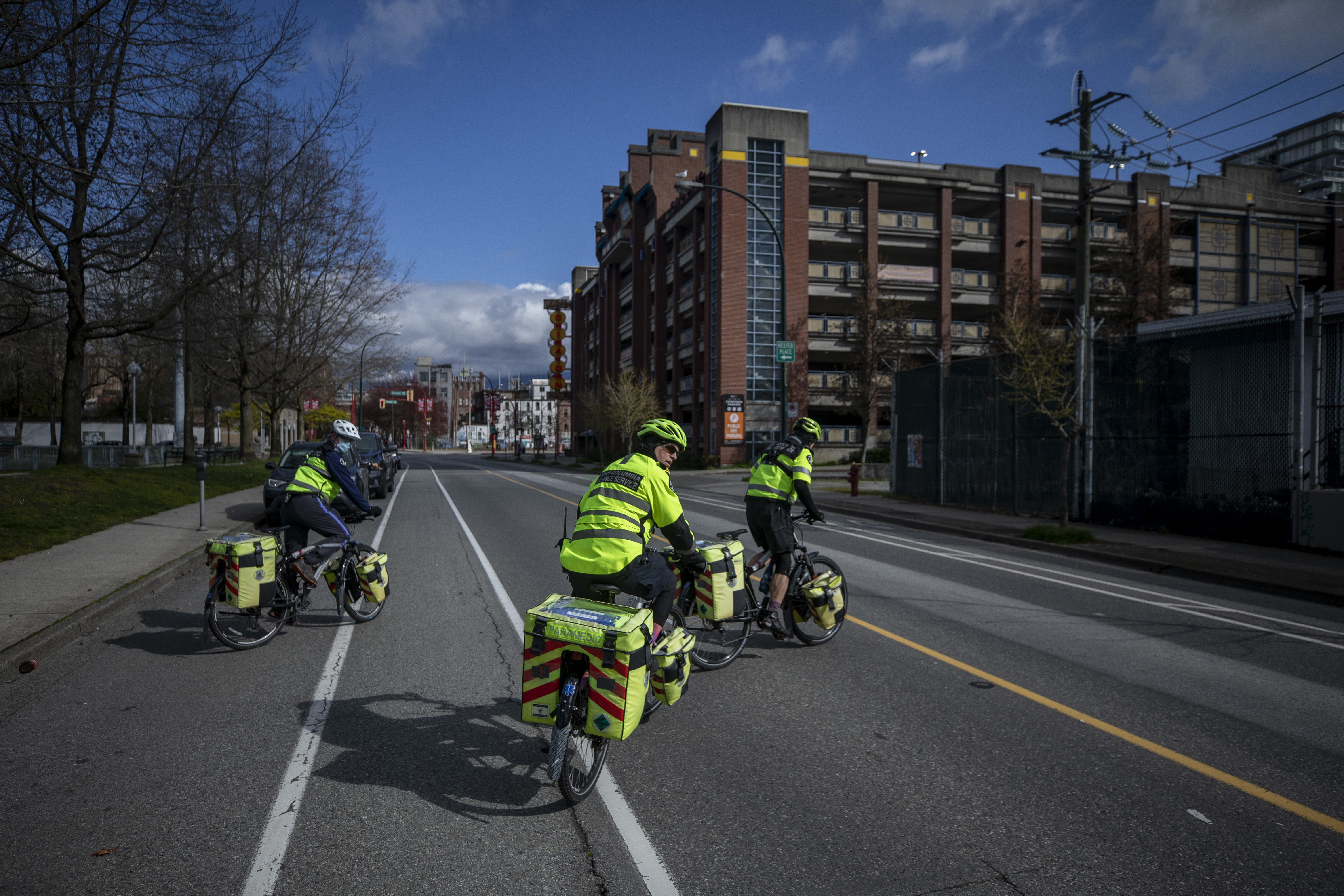Left to right, Rodney Siudut, Darren Metta and Tom Venables, paramedics with the 248 Squad, cross Quebec Street in Vancouver on their way to an overdose call at the Carnegie Community Centre. (Ben Nelms/CBC)