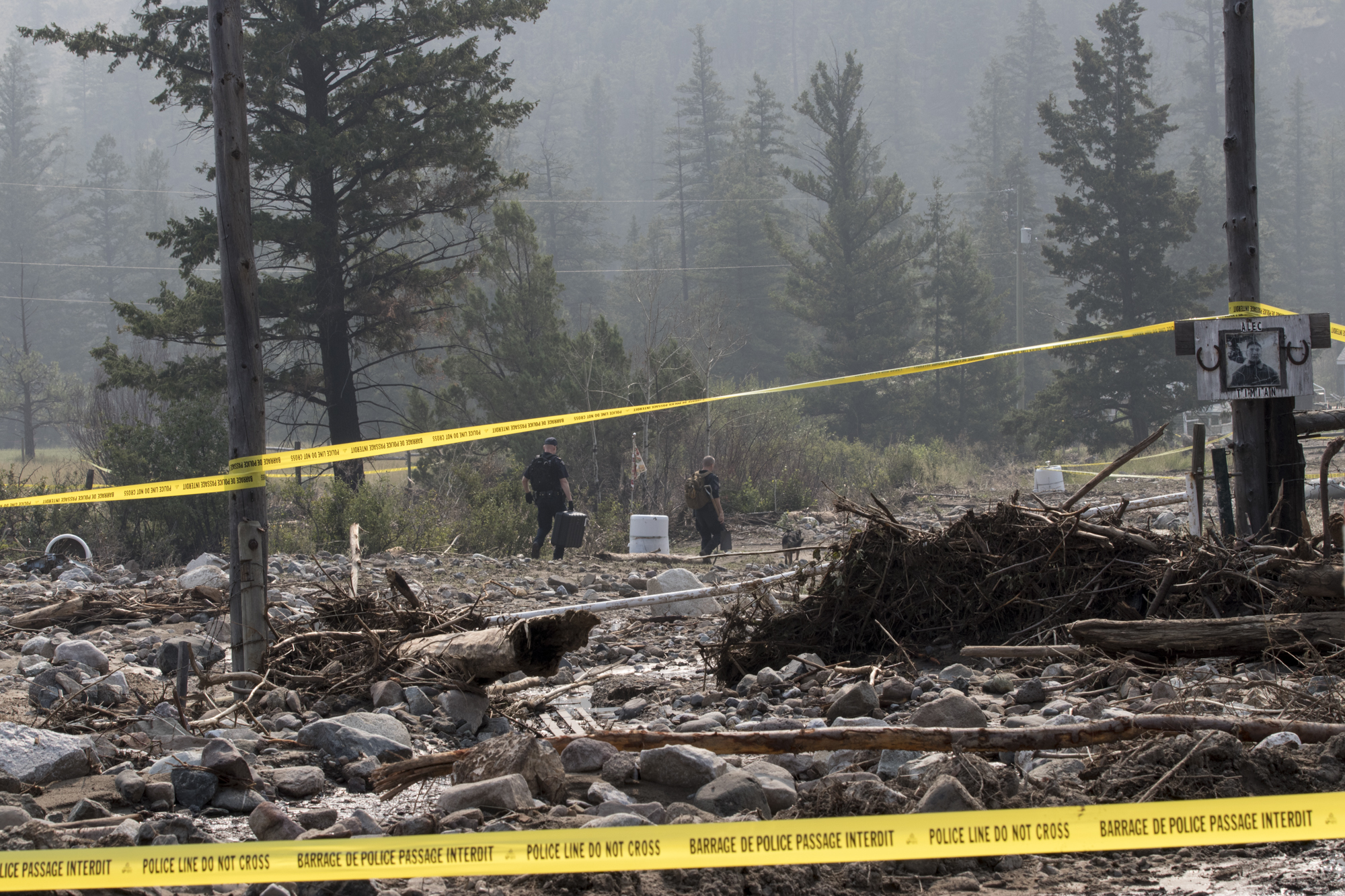 Police dogs with the help of drones set out to find a woman who was swept away by the mudslide along Highway 99 earlier in August. (Tina Lovgreen/CBC)