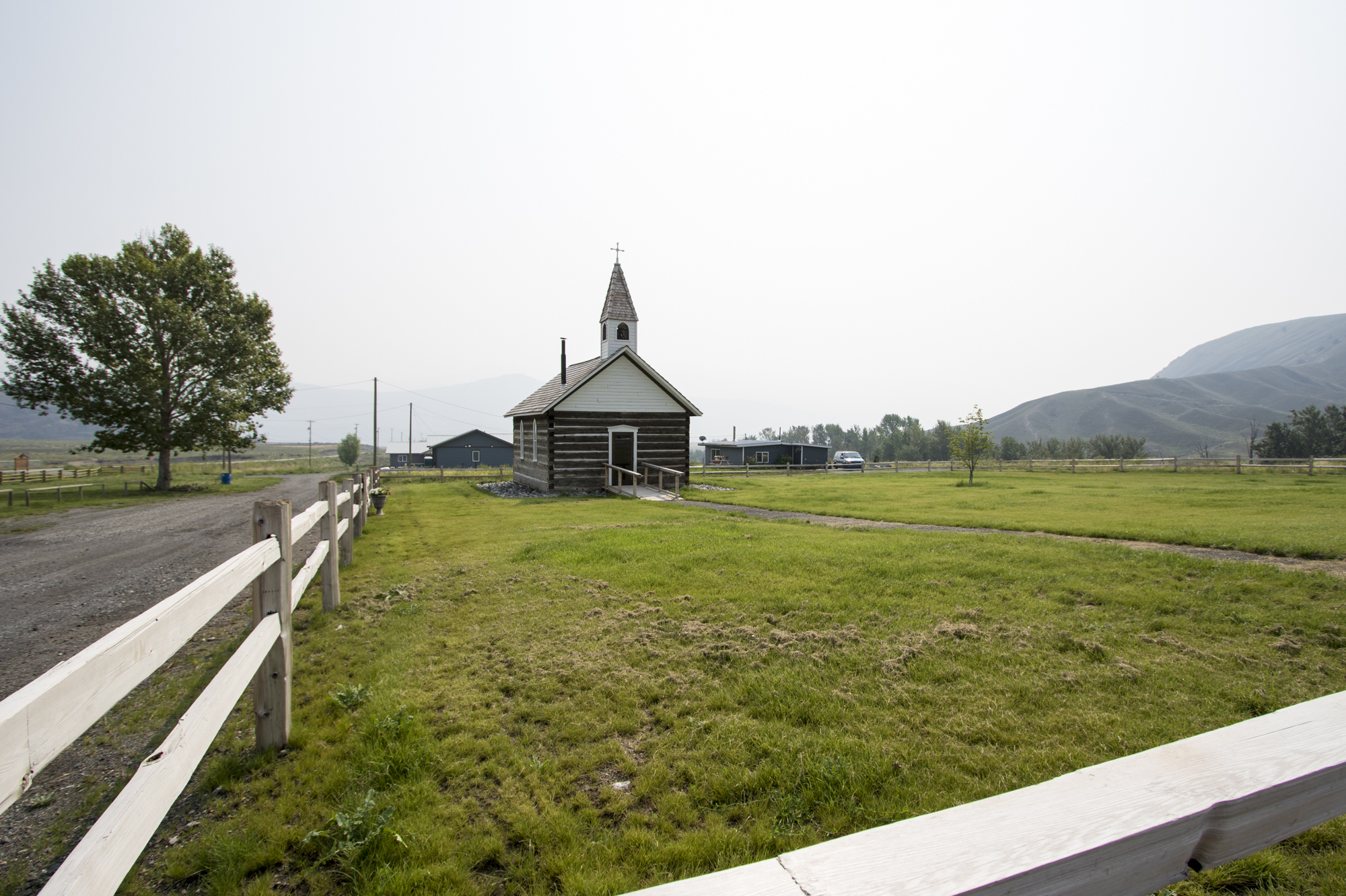 This church on the Ashcroft Indian Band reserve was one of the few things left untouched by flames in 2017. Today, grass around the historic building signals regrowth in the community. (Tina Lovgreen/CBC)