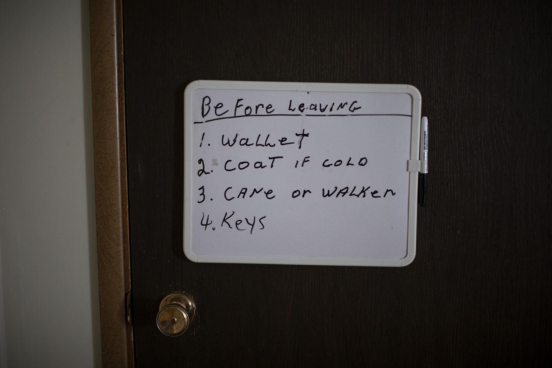 A sign on the door of Rolf-dieter Klose's home. (Ben Nelms/CBC)