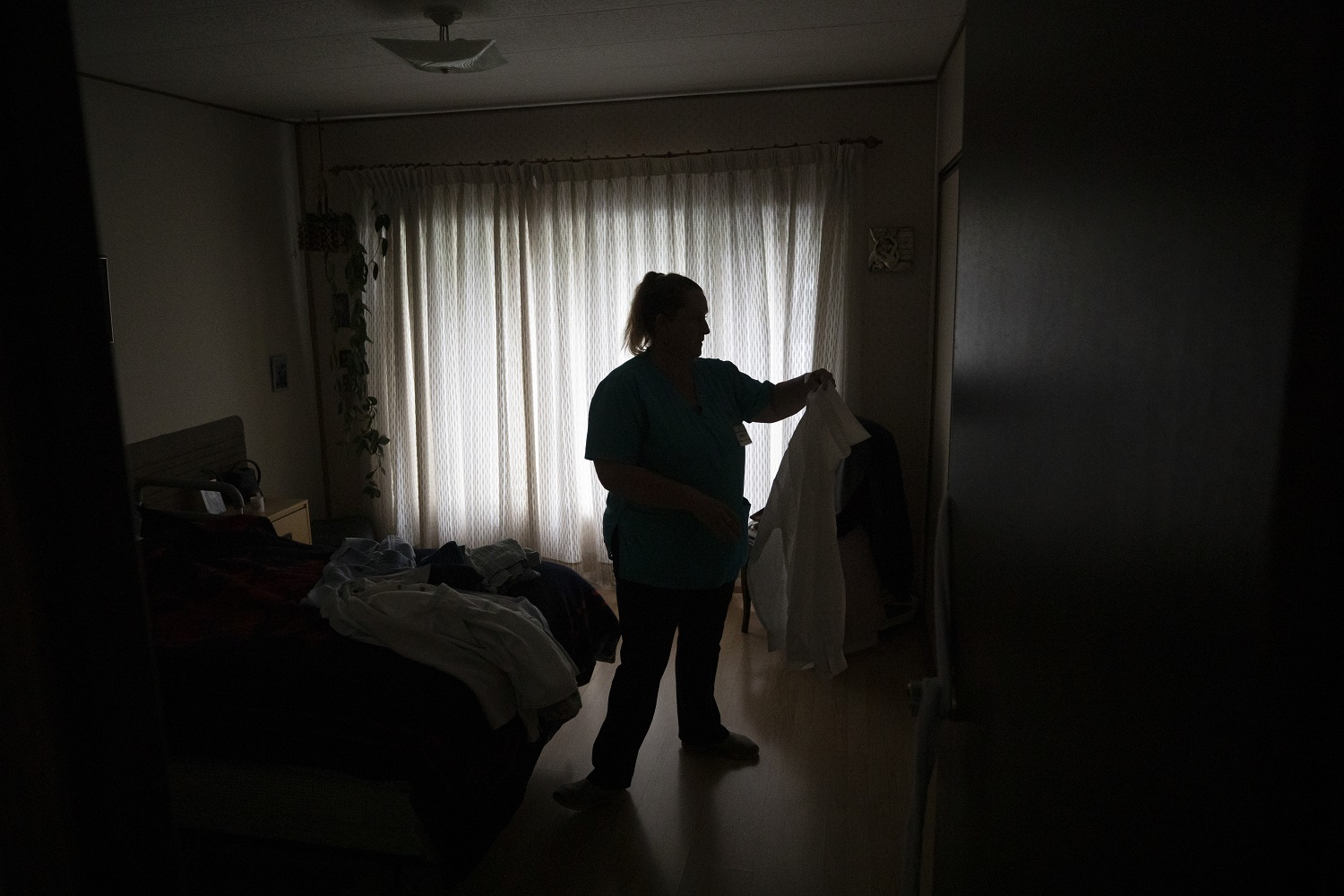Care worker Jenny Kaastra works until late, with her shift totaling 12 hours. (Ben Nelms/CBC)
