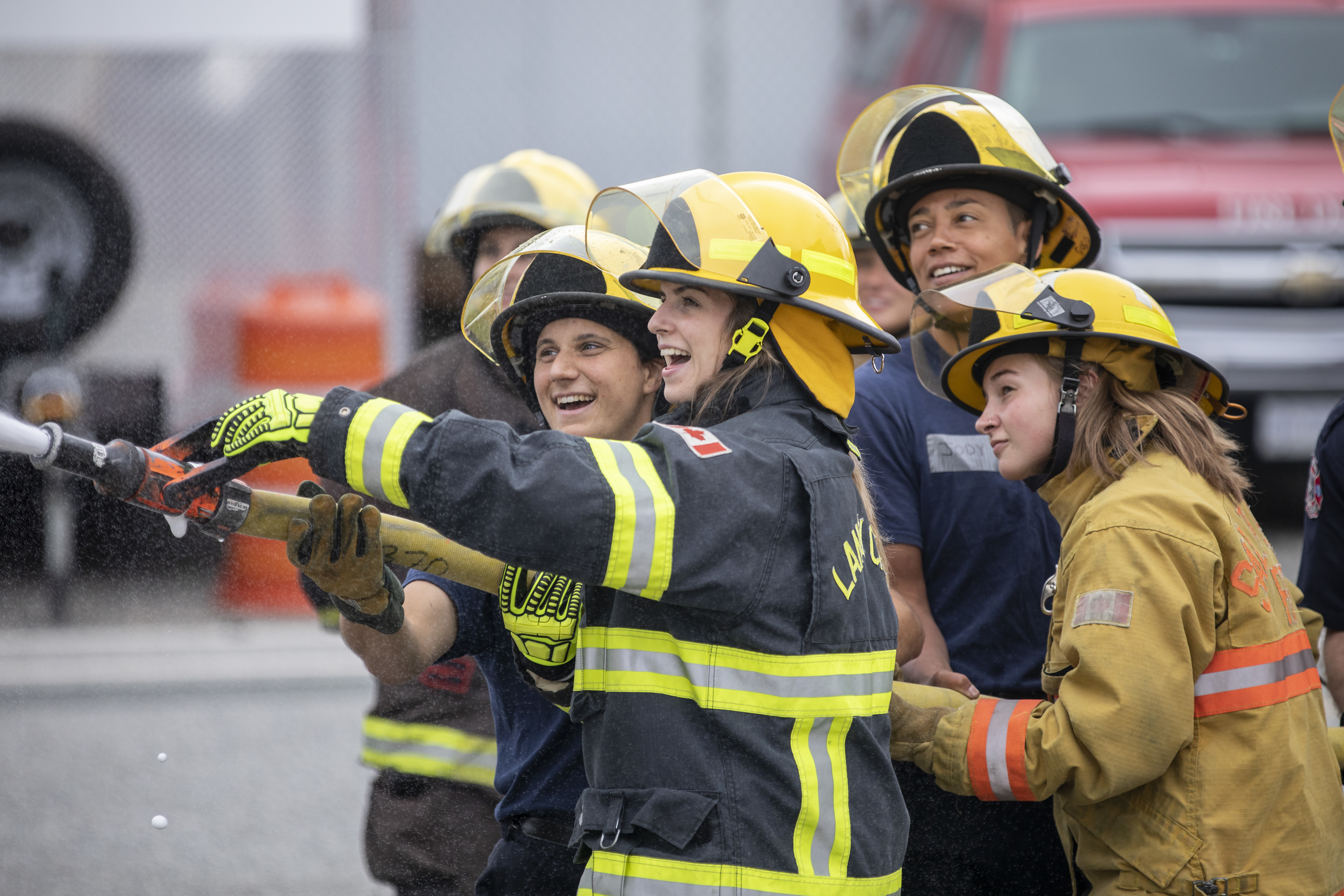 At one of the training stations, participants tried putting out a fire in a building at the training centre. (Ben Nelms/CBC)