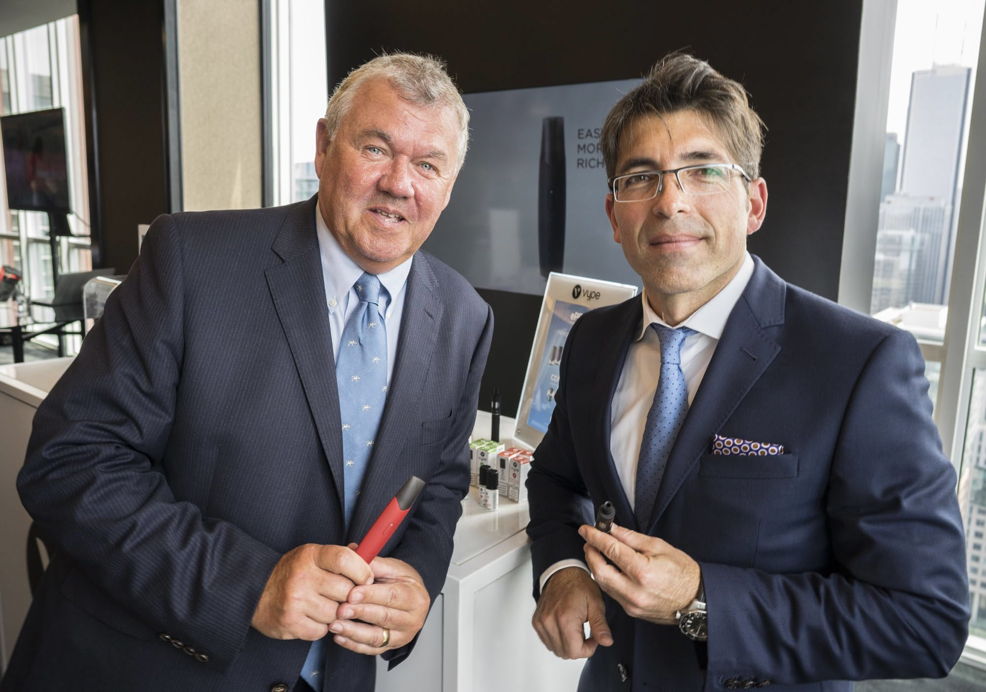 Chris Proctor, chief scientific officer of British American Tobacco, left, and Jorge Araya, president and CEO of Imperial Tobacco Canada, a subsidiary of BAT, announcing a national roll-out of Vype vaping products in Toronto in May 2018. (Imperial Tobacco Canada/The Canadian Press)