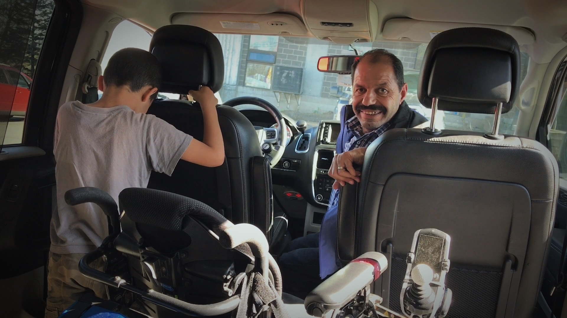 Mohammad and Younes in the van. (Dave Irish/CBC)