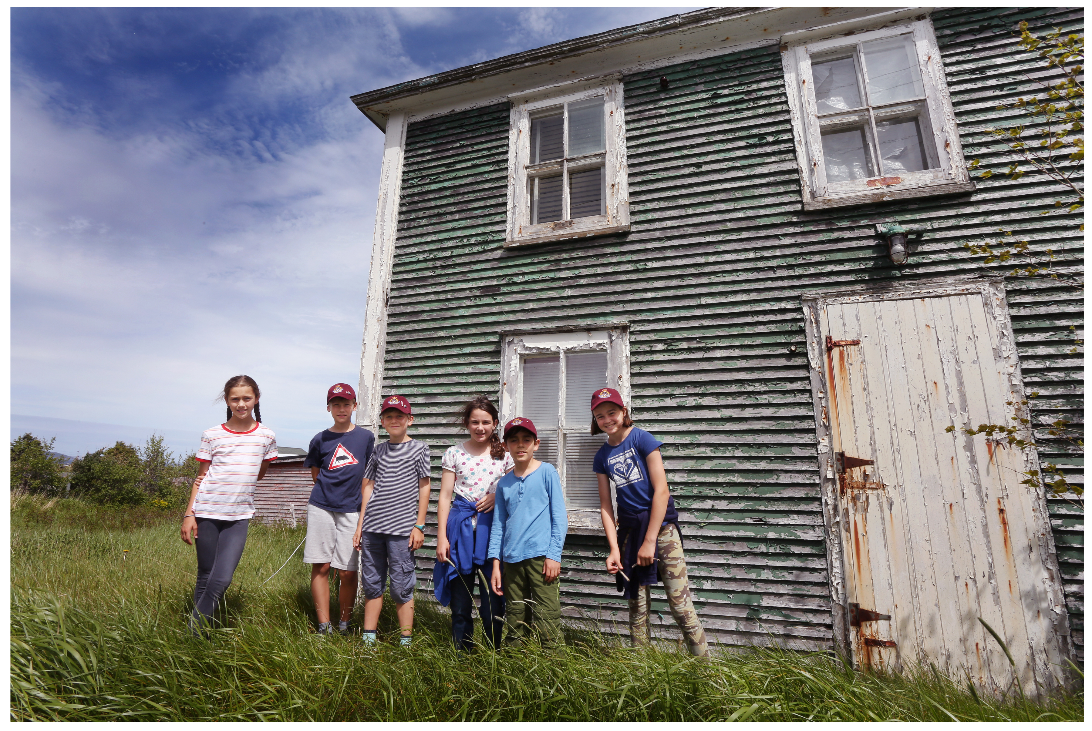 Students Sophia Anderson, George Overy, Oscar Heard, Alice Goldberger, Sasha Cellino and Zoe Spenceley at the home of Silas Edgecombe in Ochre Pit Cove. (Paul Daly for CBC)