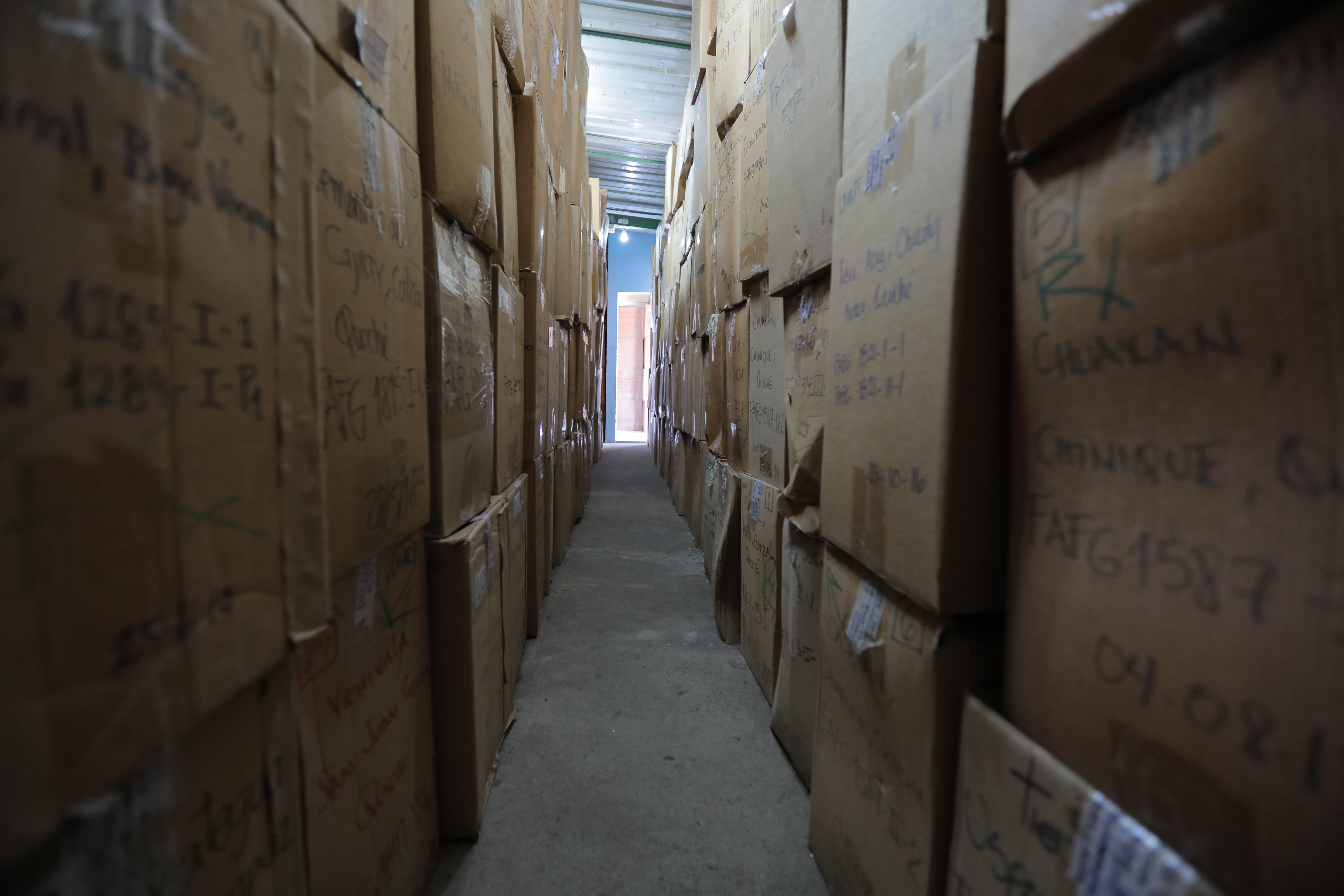 Boxes containing remains from mass graves wait to be identified at FAFG headquarters in central Guatemala City. (Nahlah Ayed/CBC)