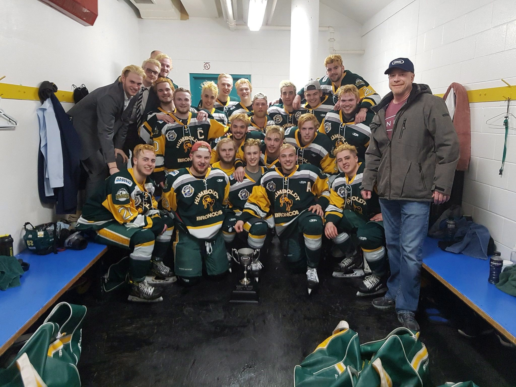 Thr Broncos celebrated a playoff win over the Melfort Mustangs on March 24, 2018. (Canadian Press)