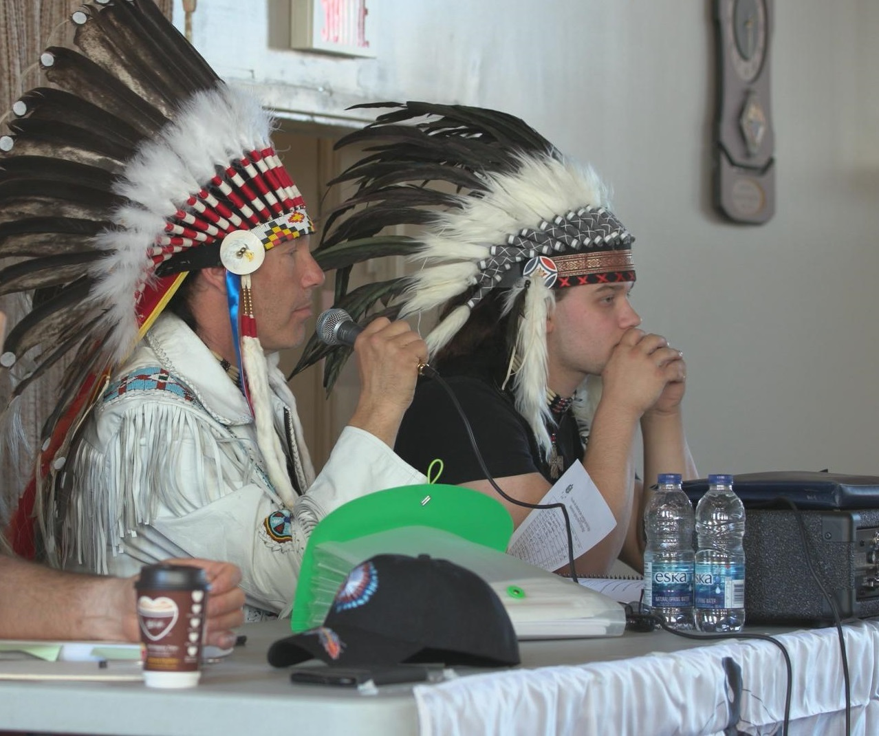CAPC leader Guillaume Carle, left, at a recent meeting of the organization. (CBC)
