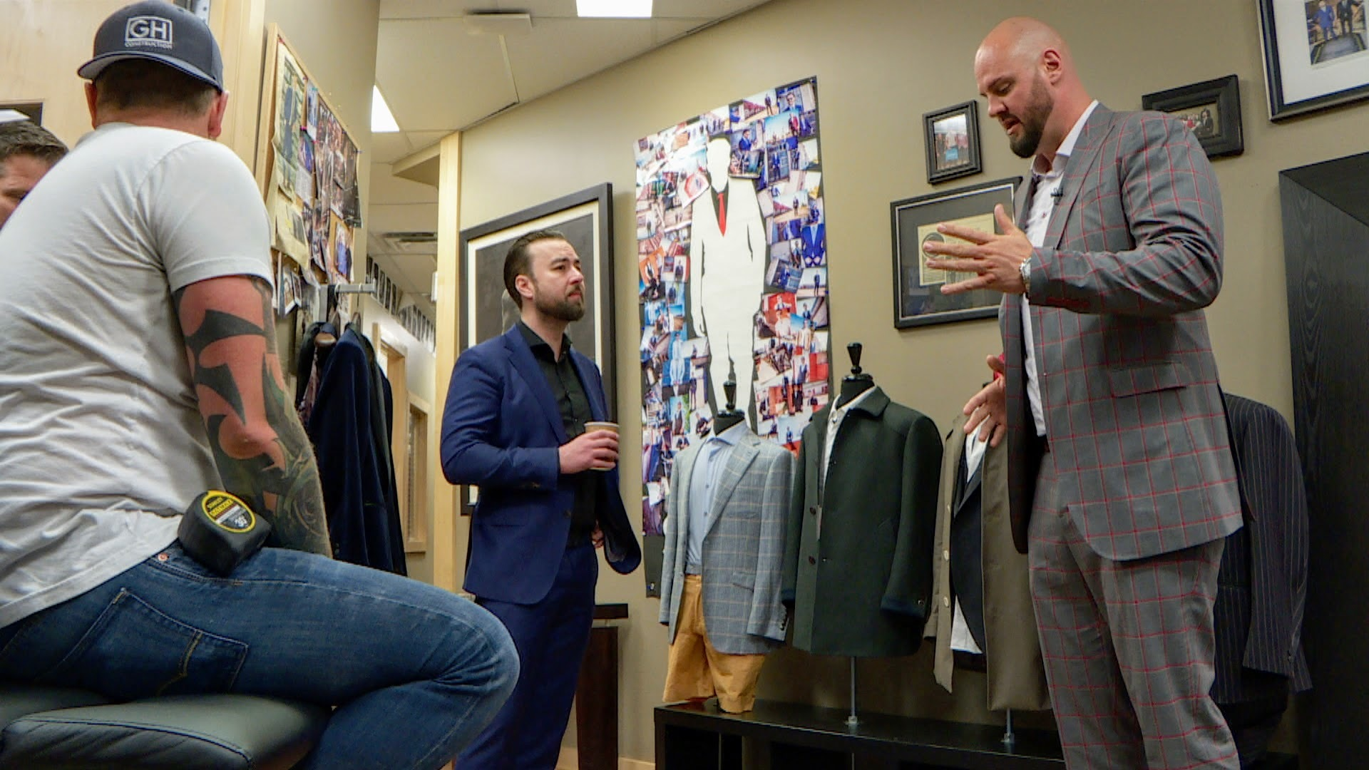 Brad Switzer owns more than a dozen suits, each bearing a unique name stitched inside. (Min Dhariwal/CBC)