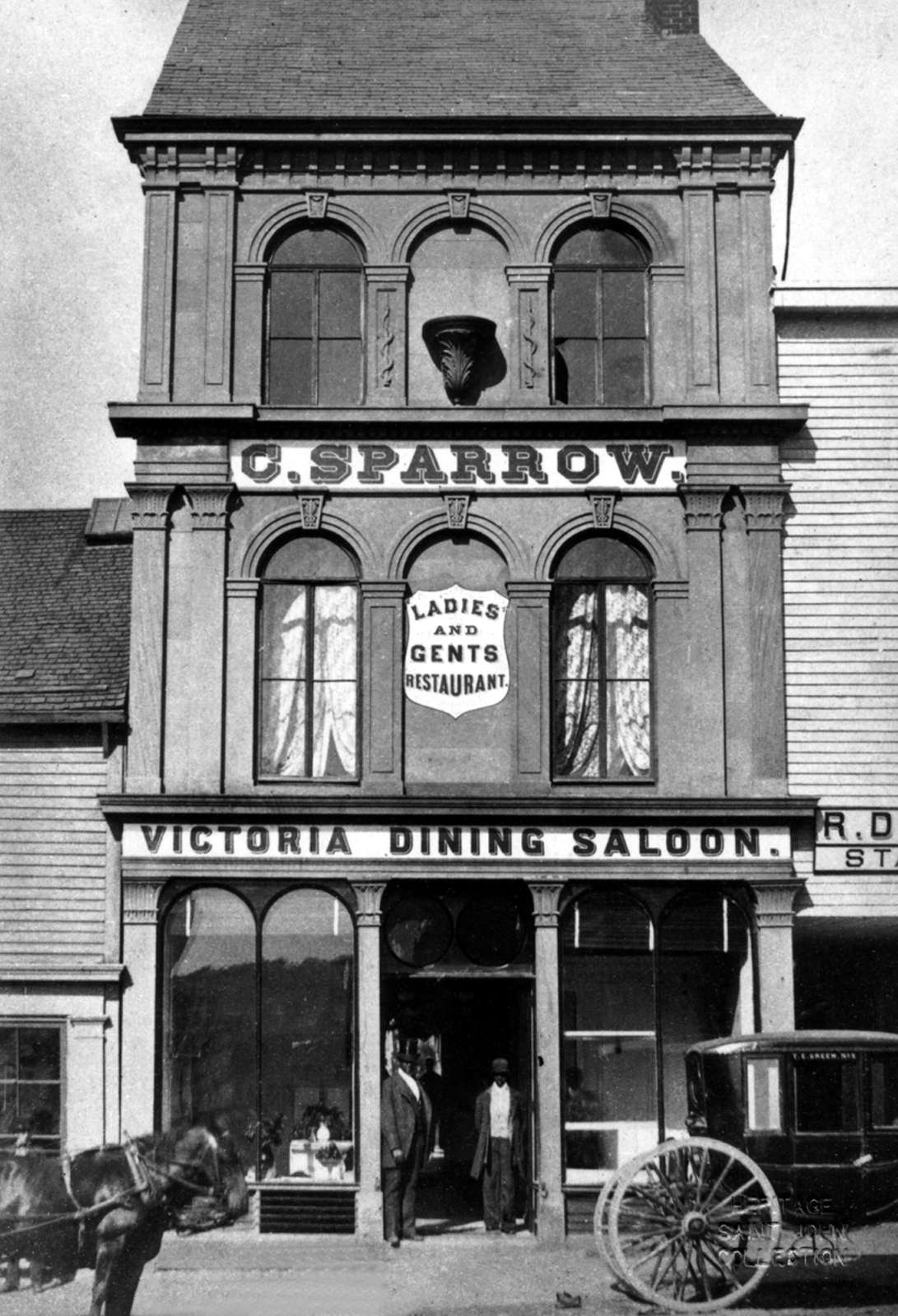 Cornelius Sparrow in front of the Victoria Dining Saloon on Germain Street in Saint John on June 20, 1877. (Heritage Resources Saint John)