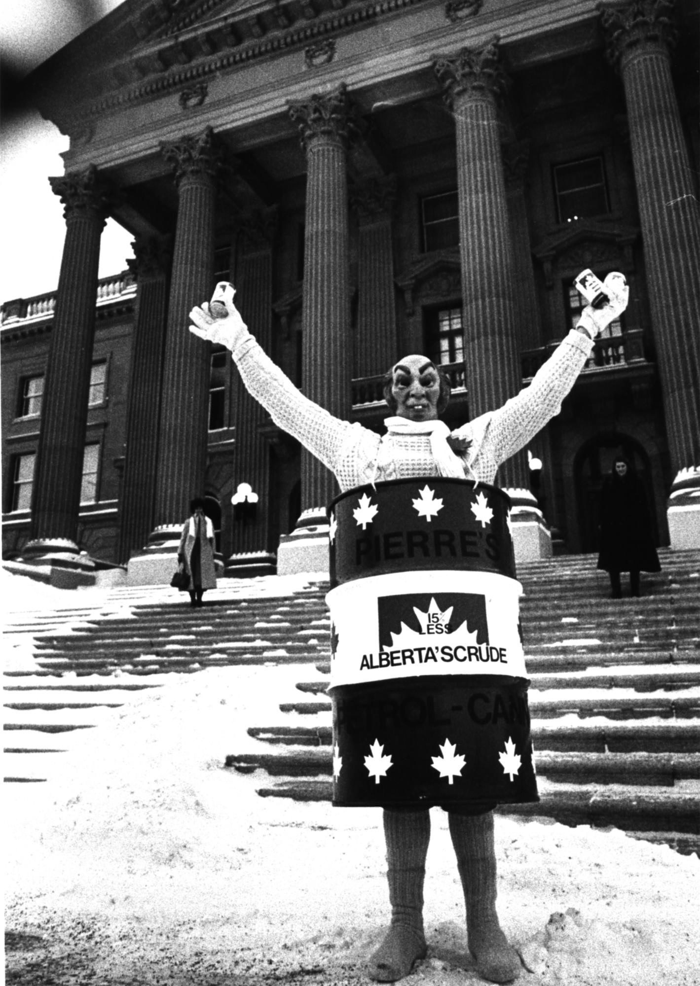 Brian Brunke wears a Pierre Trudeau mask and an oil barrel as he protests the NEP in front of the Alberta legislature on Dec. 11, 1980. Photo: The Canadian Press
