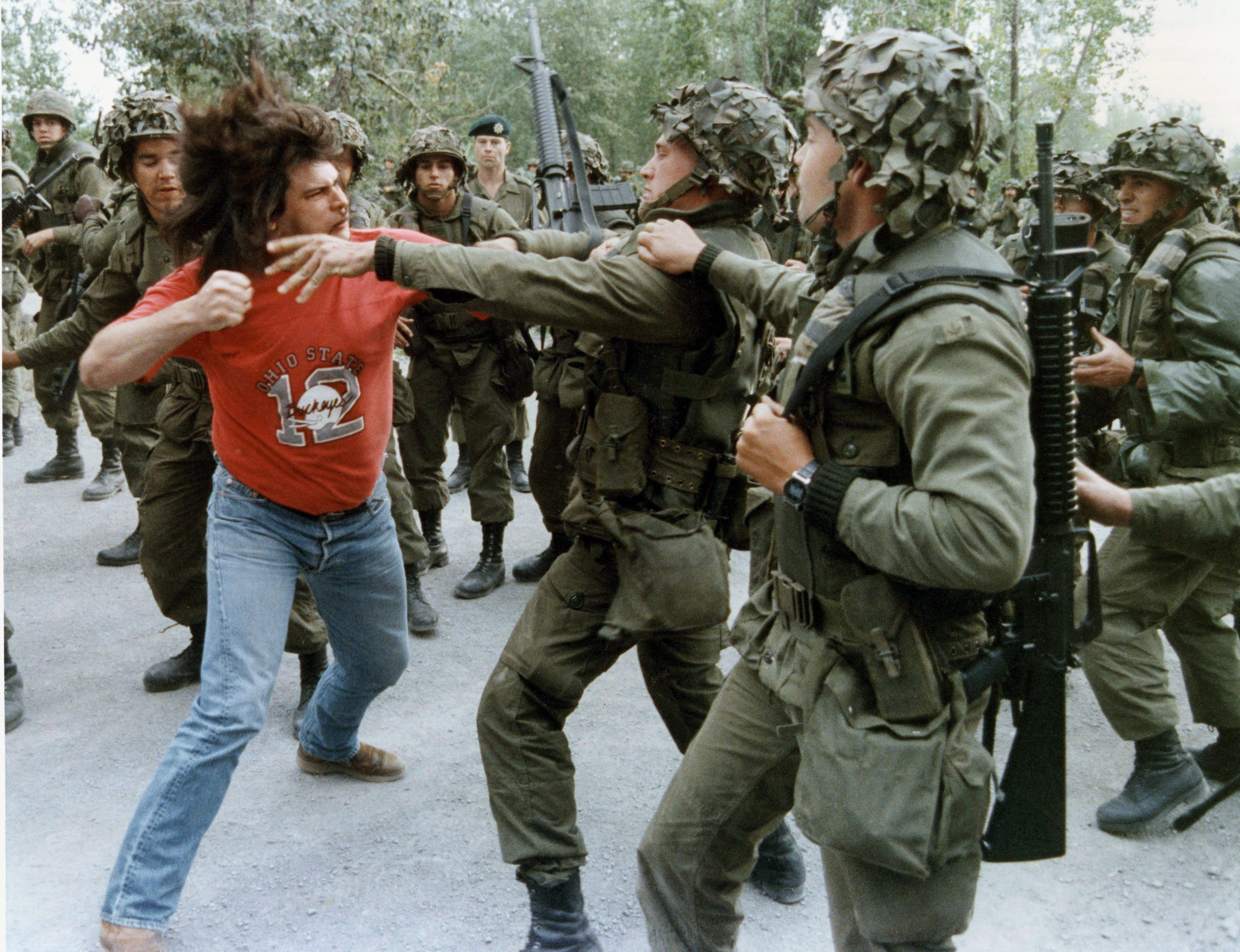 In this famous photo, Danny Phillips, a resident of Kahnawake, winds up to punch a soldier during a fight that took place in Kahnawake on Sept.18, 1990. (Tom Hanson/The Canadian Press)
