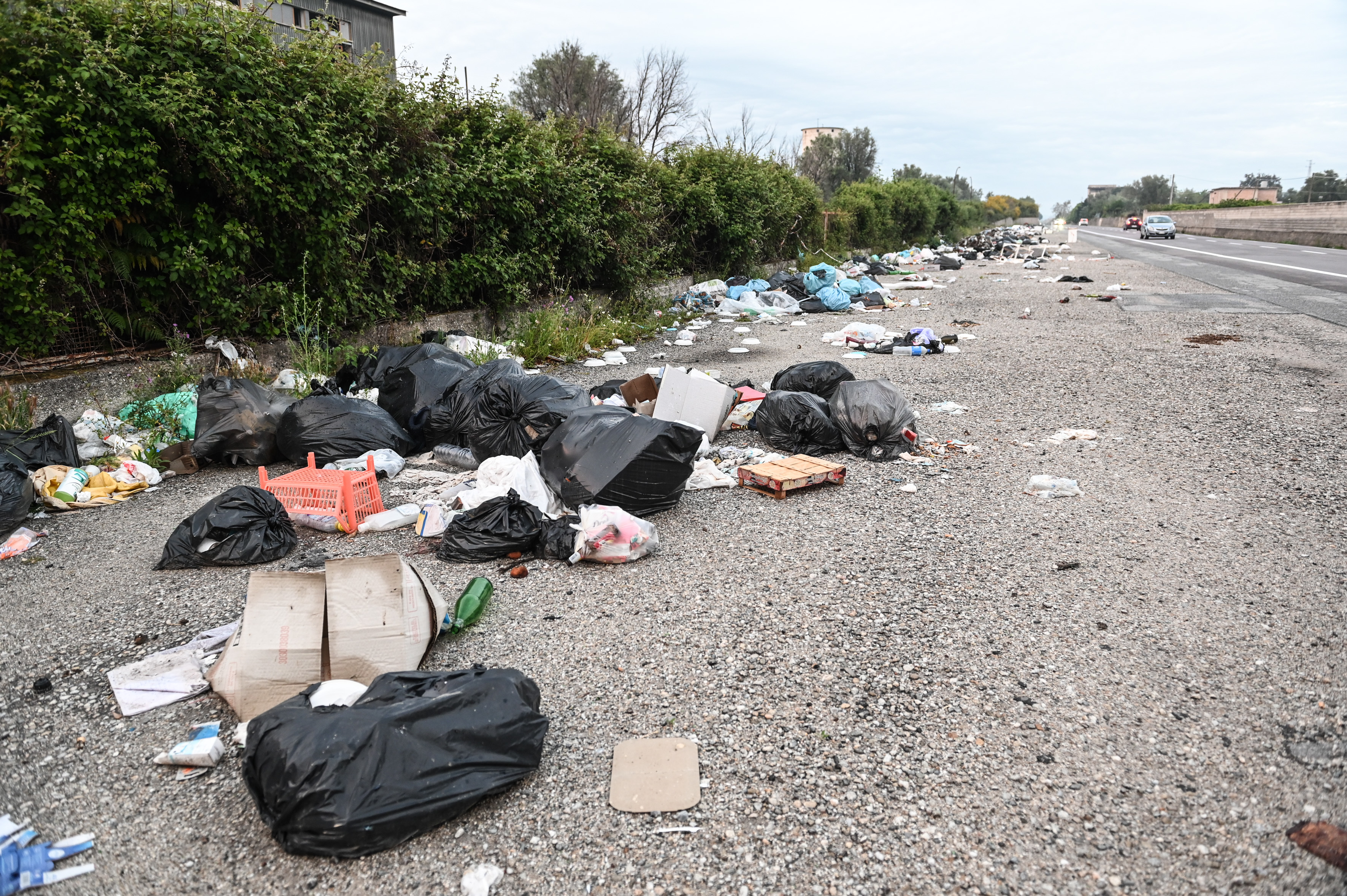 Garbage strewn along a stretch of road is one of many signs of the hostility towards public space expressed in Mafia cultures. (Chris Warde-Jones)